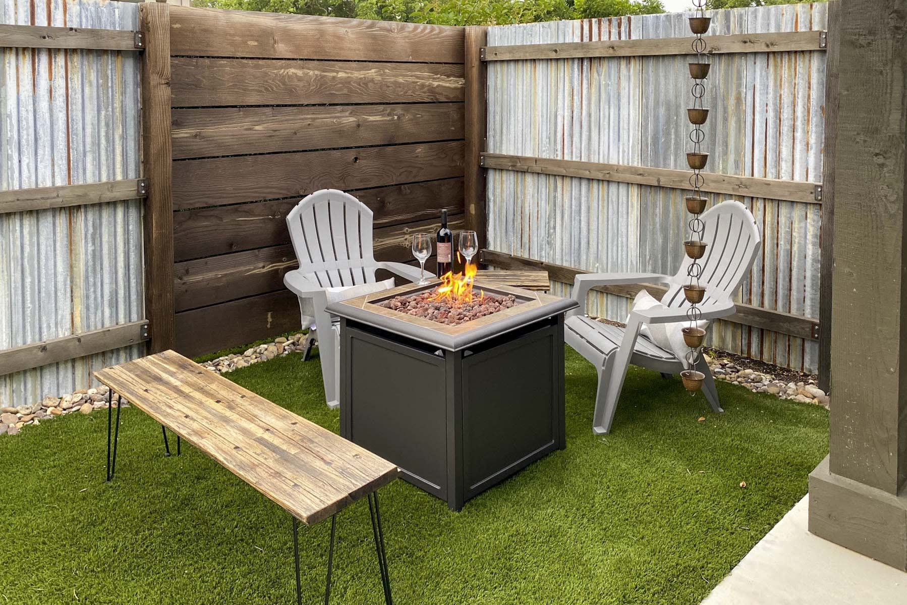 End the evening around the brand new propane fire pit!