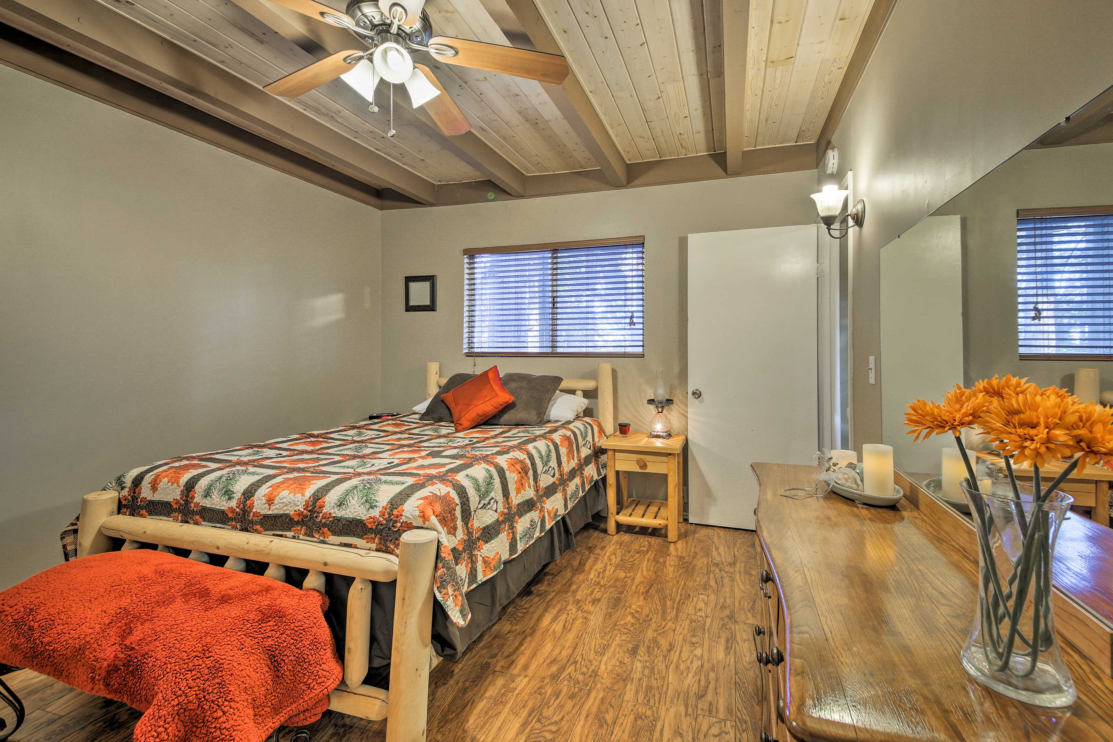 Another queen bed highlights this well-appointed bedroom.