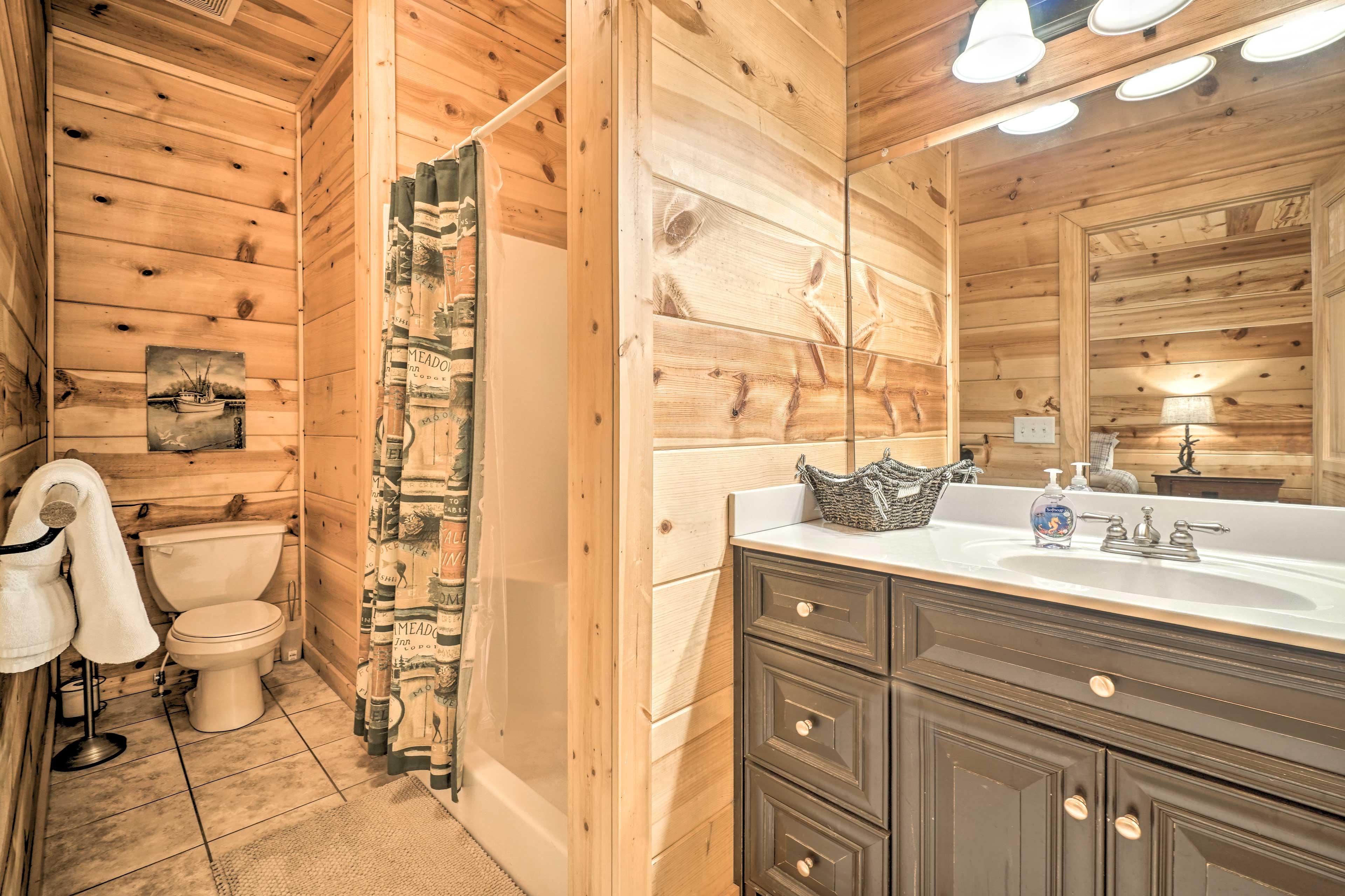 The en-suite bathroom features a walk-in shower.