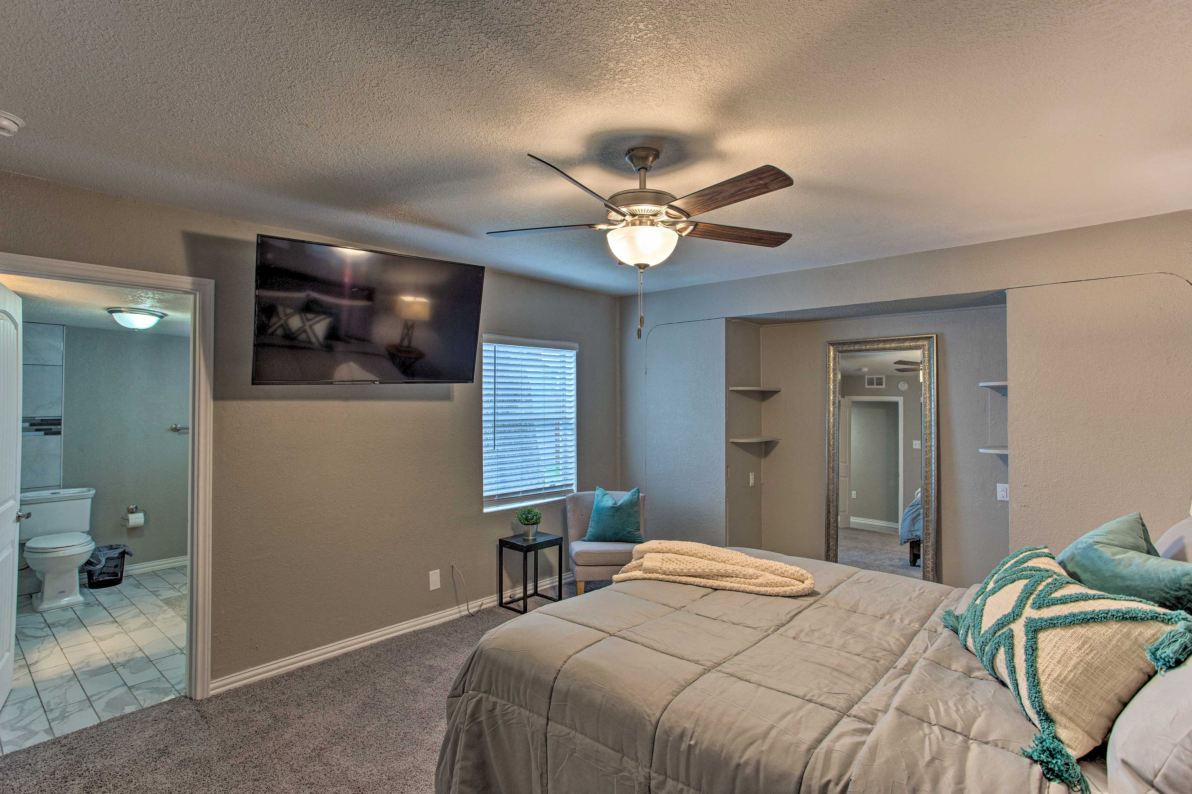 This master bedroom is home to a queen bed.