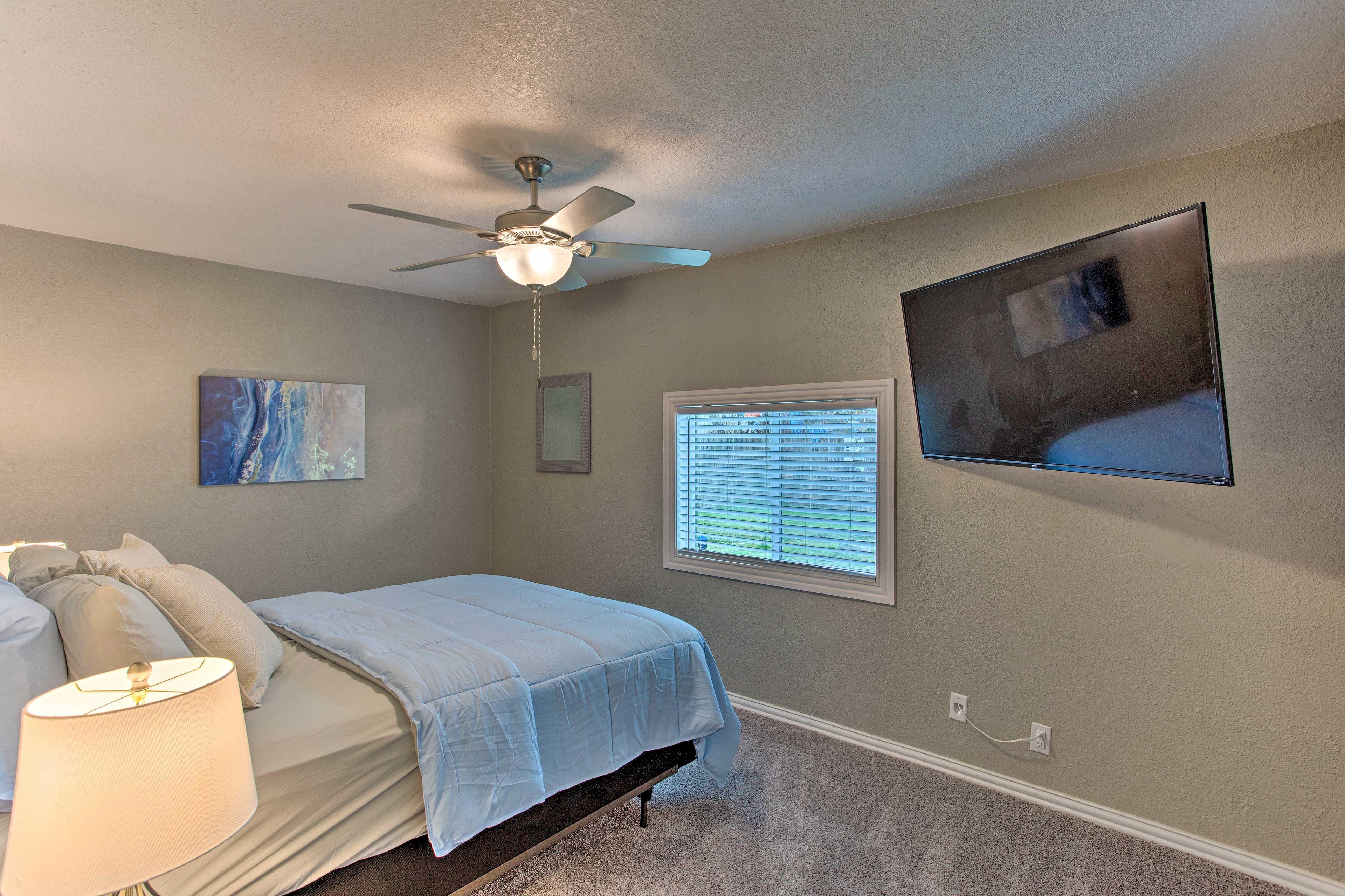 Claim this queen bed for your time in Arlington.