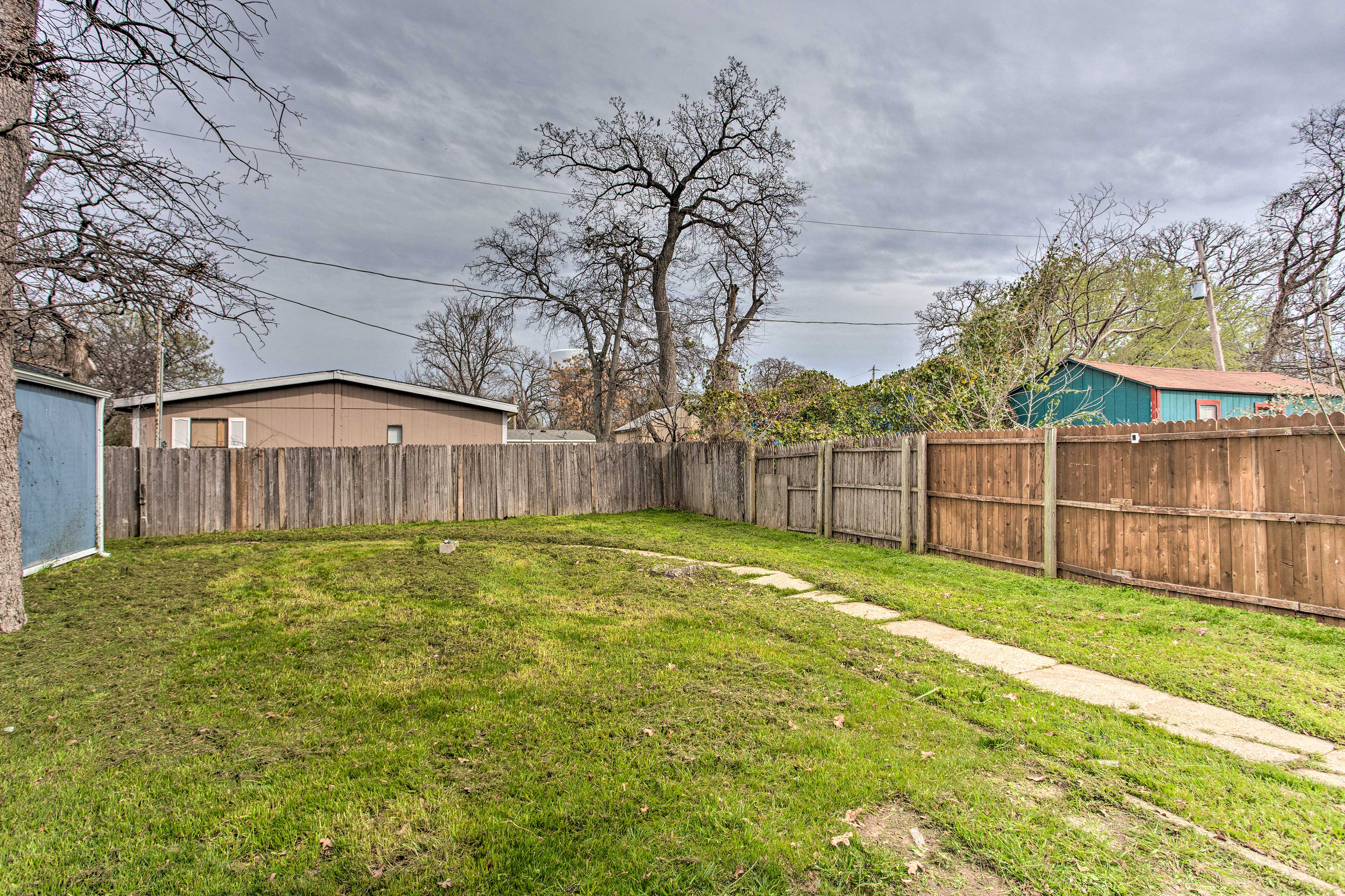 Let the kids frolic in this fenced-in backyard.