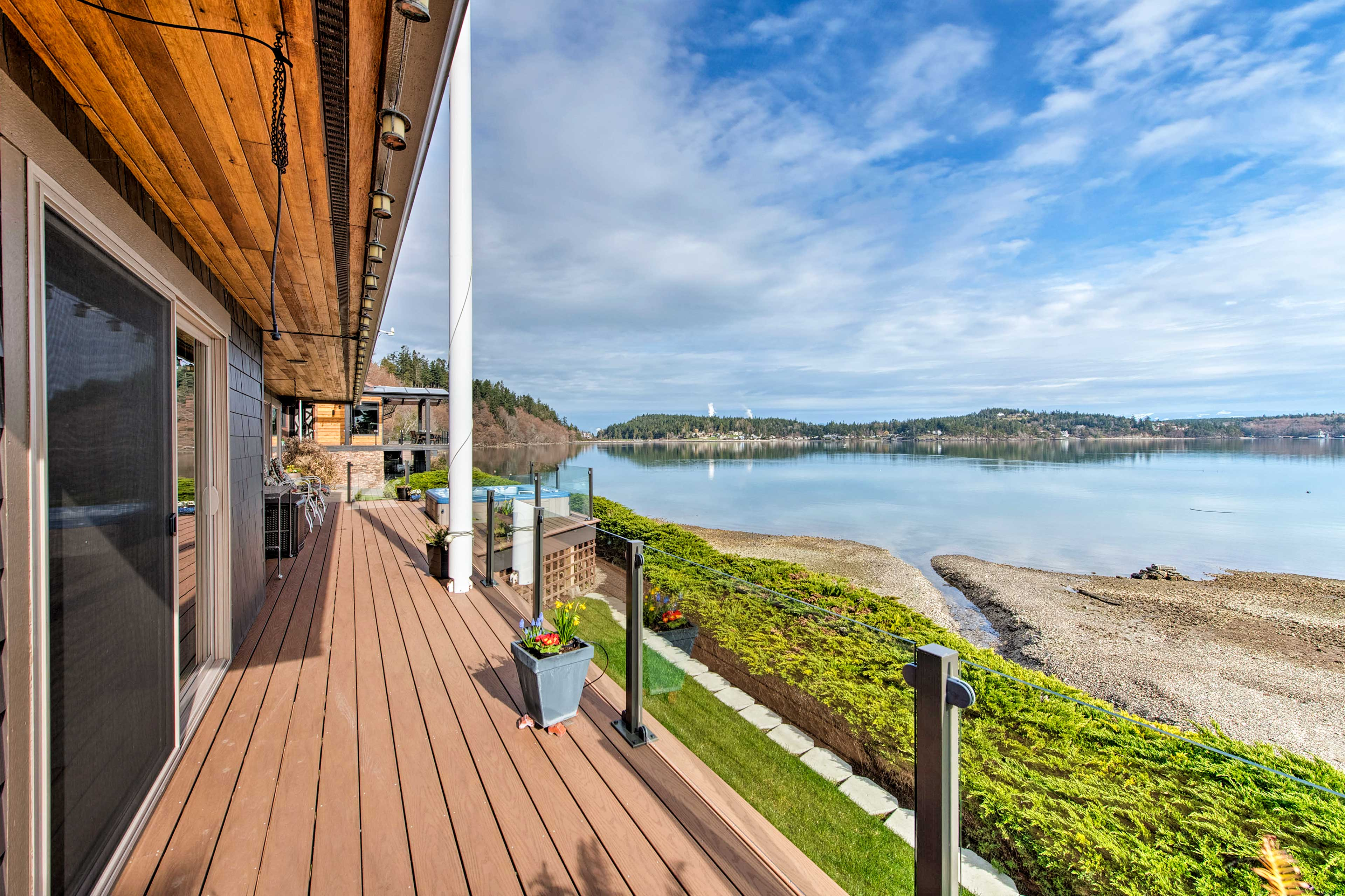Glass walls enclose the spacious wraparound deck and provide a sleek look.