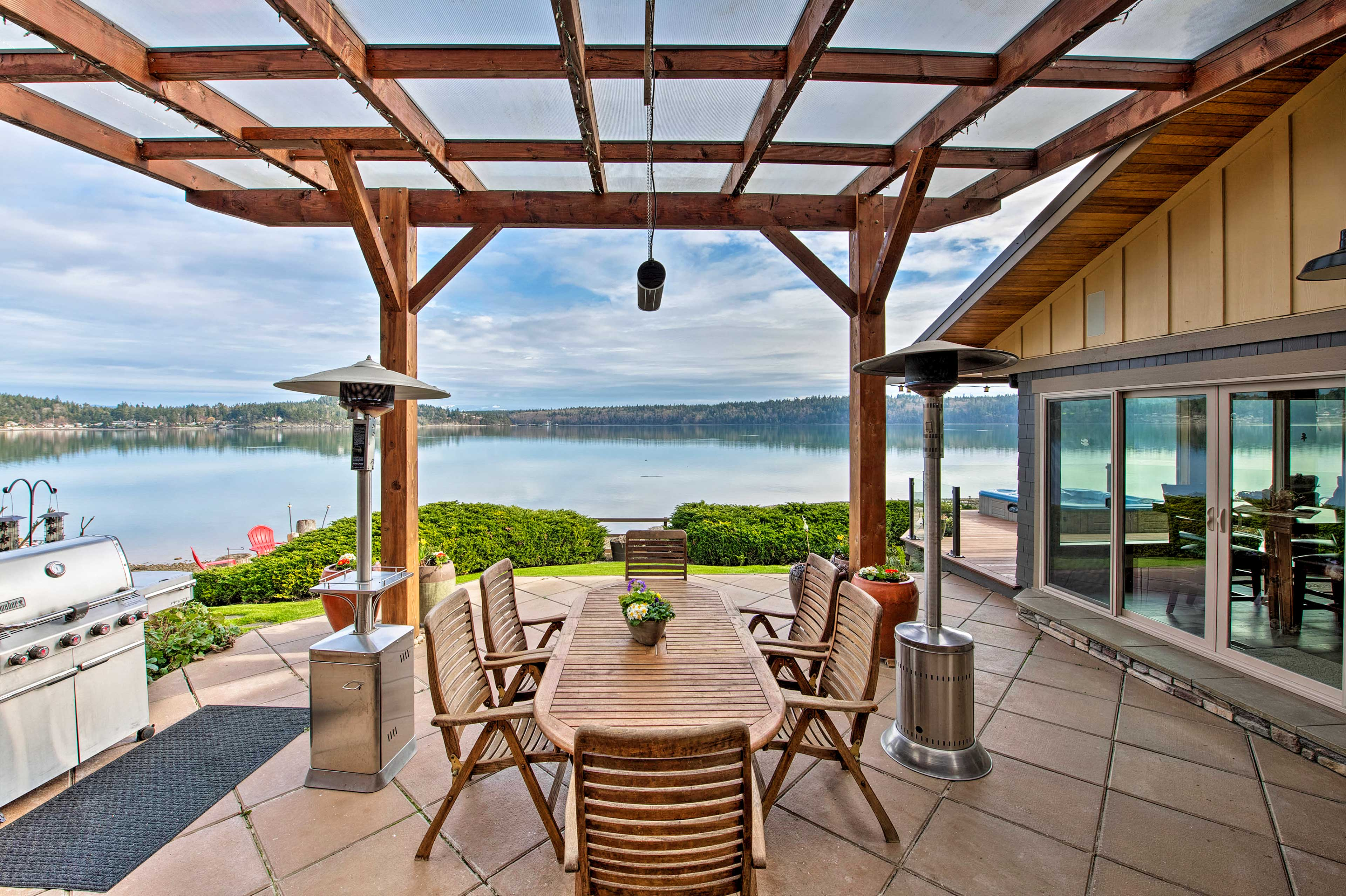 Escape to this stunning compound nestled on the shores of scenic Similk Bay!