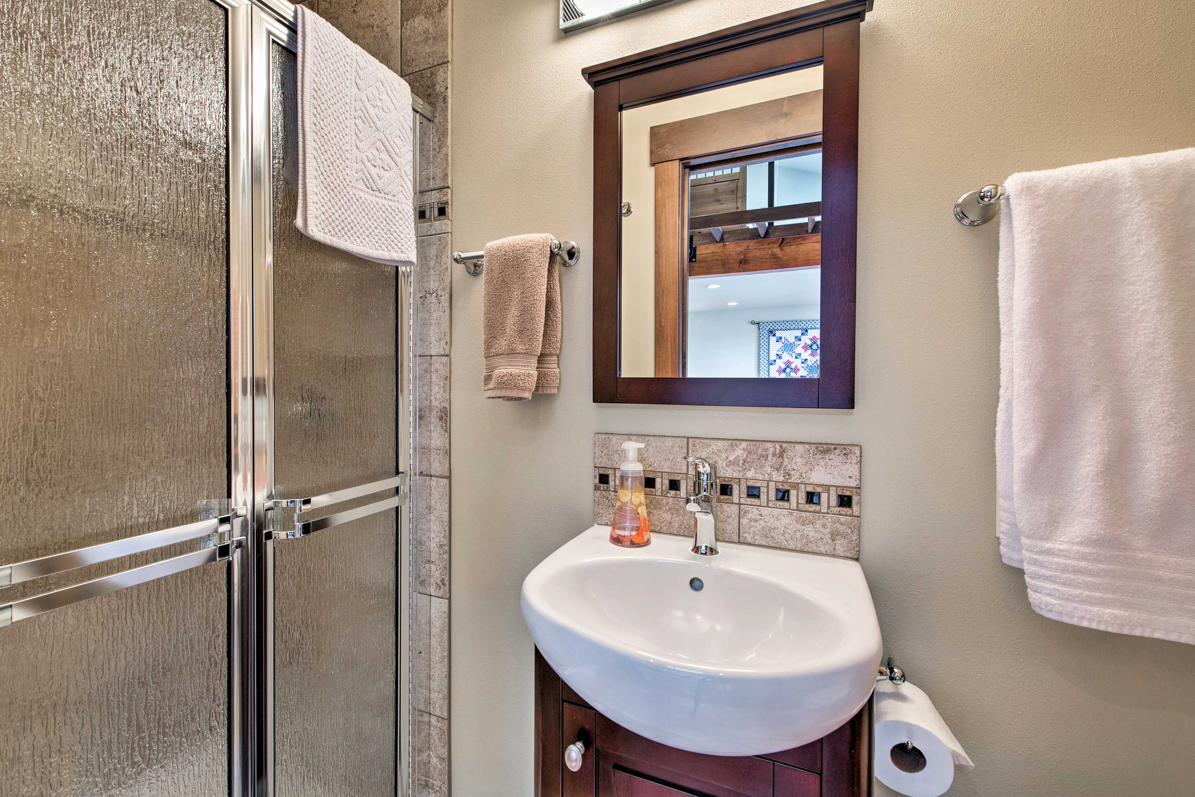 The second full bathroom is located inside the first detached suite of the house