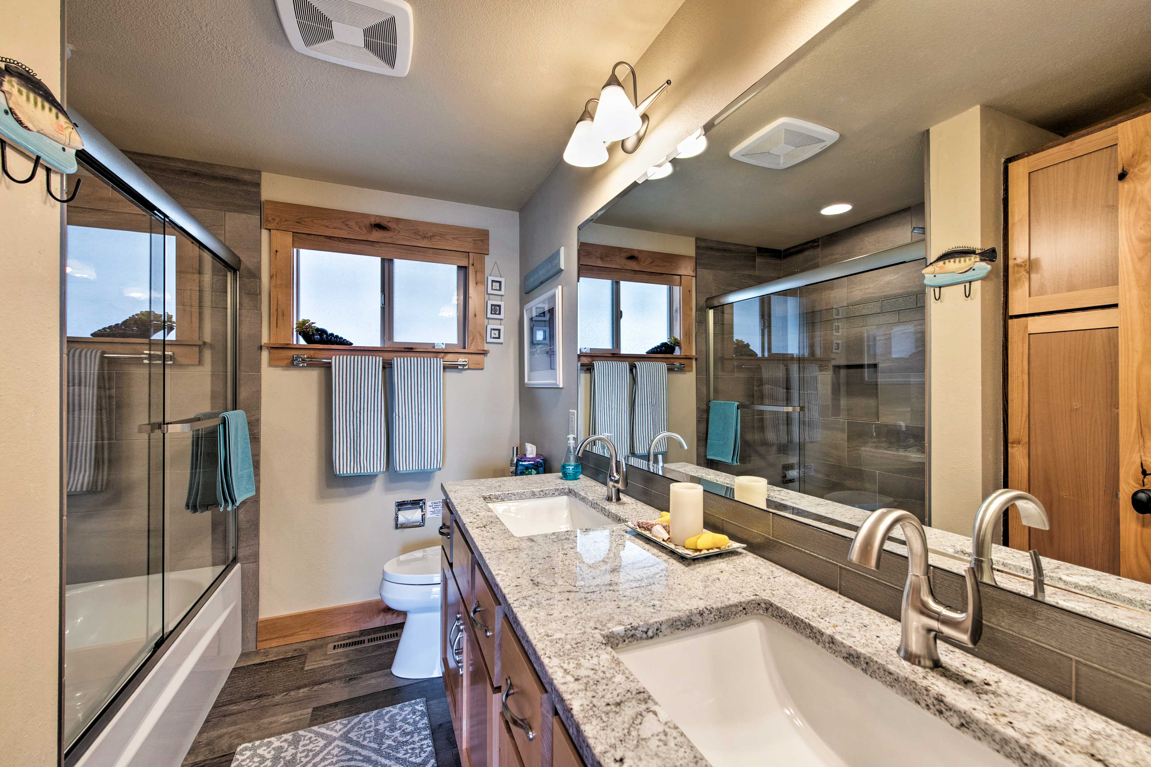 Dual sinks provide plenty of space to freshen up in the master bathroom.