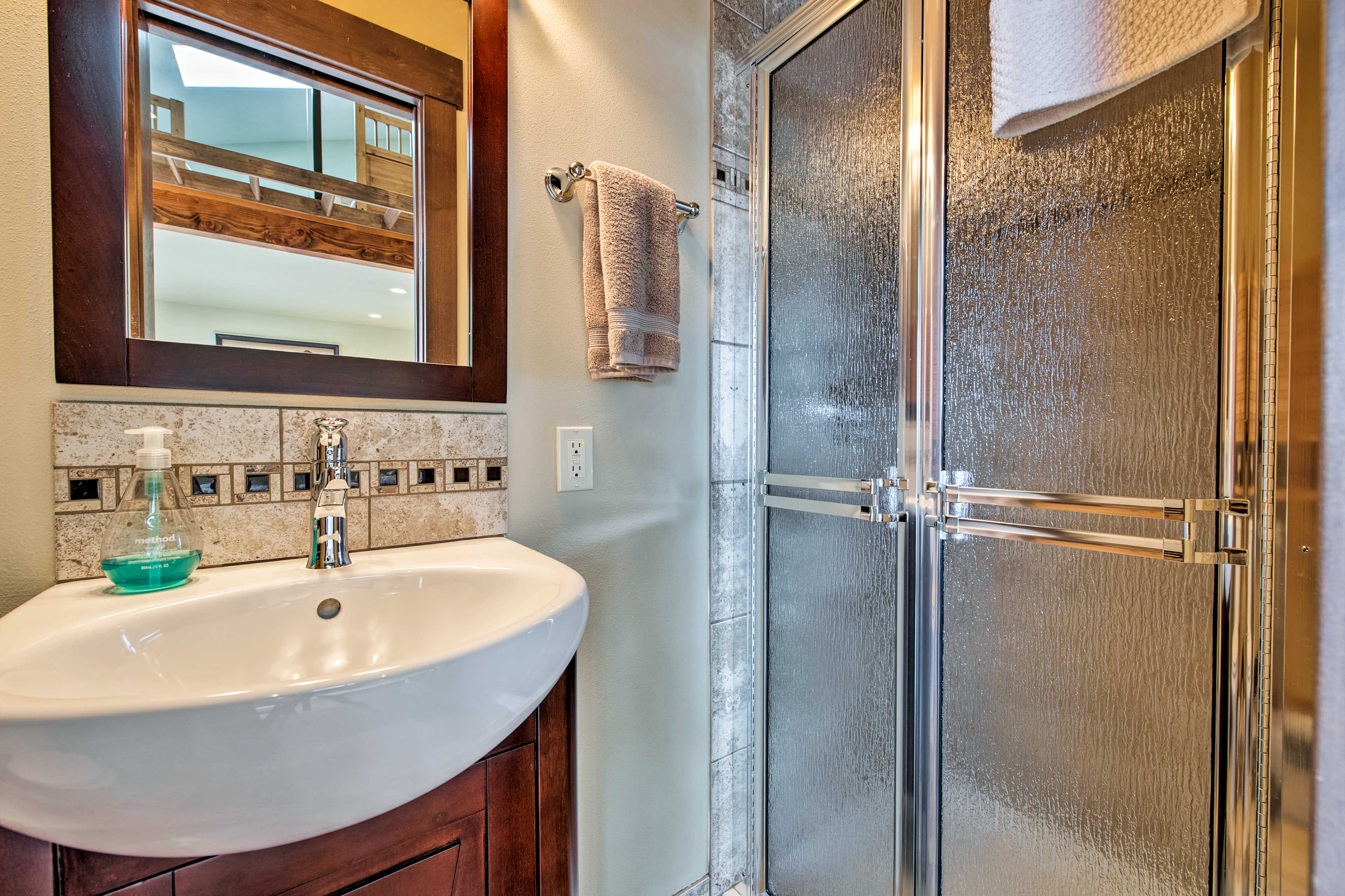 The third full bathroom is located inside the second suite of the house.