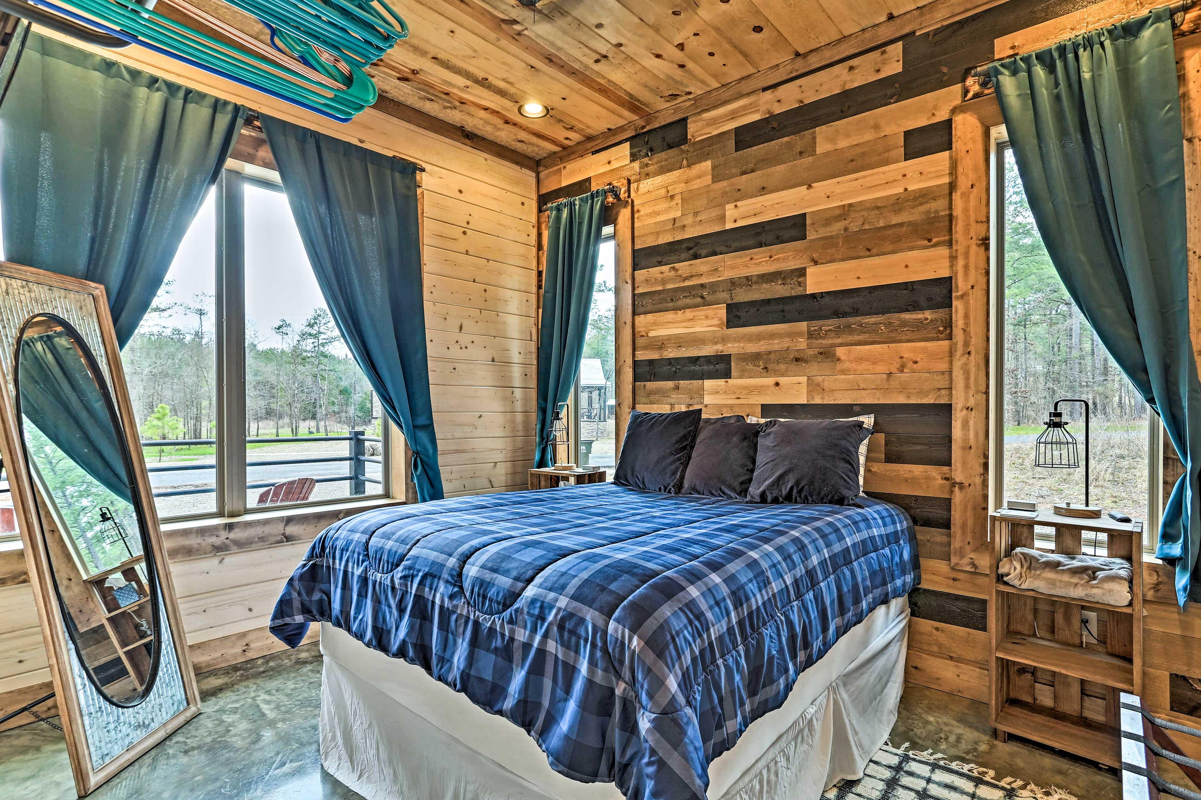 Let your worries melt away as you lay in the queen bed of bedroom 2.