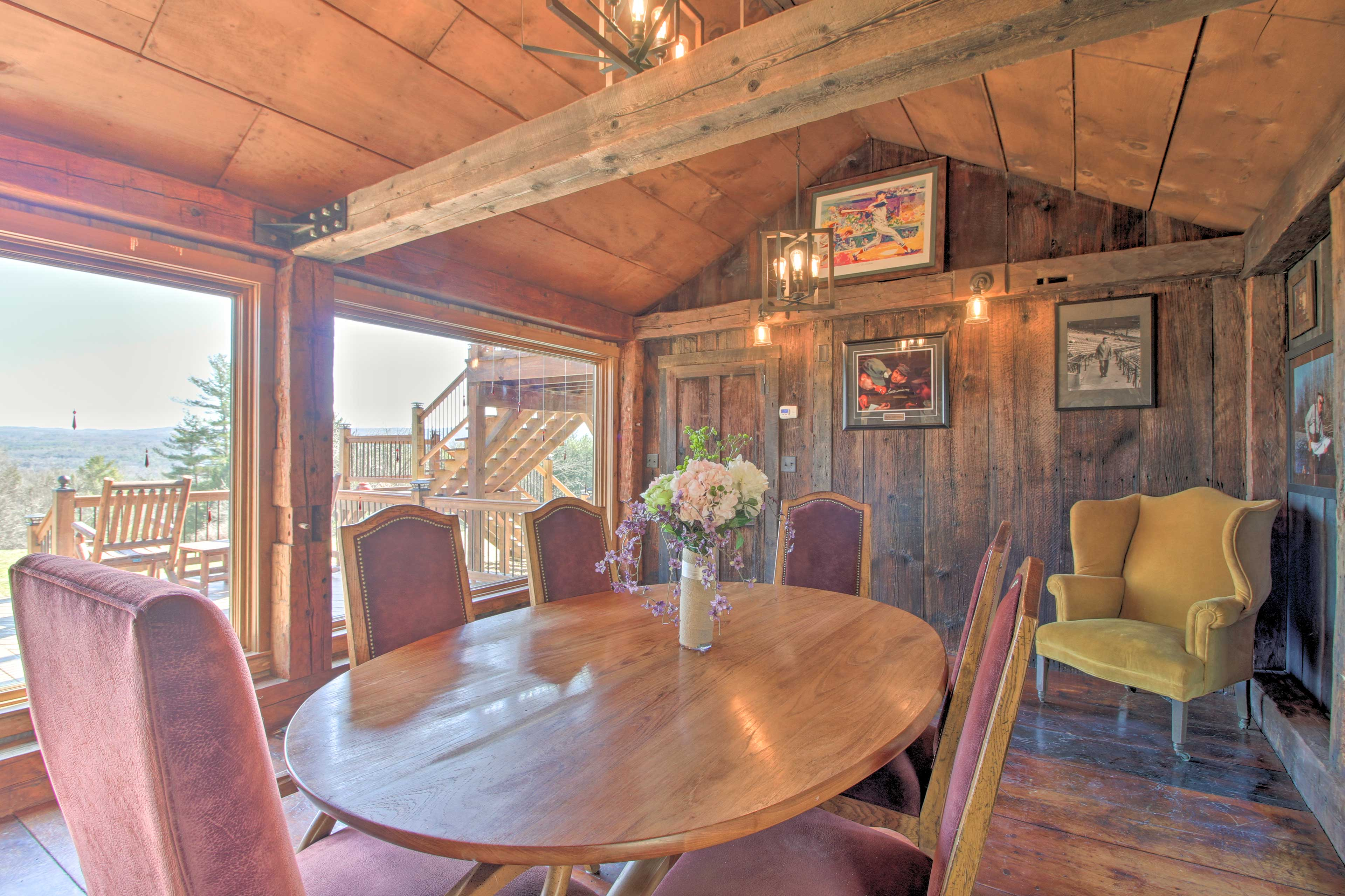 The formal dining room has picture windows and authentic cabin touches.