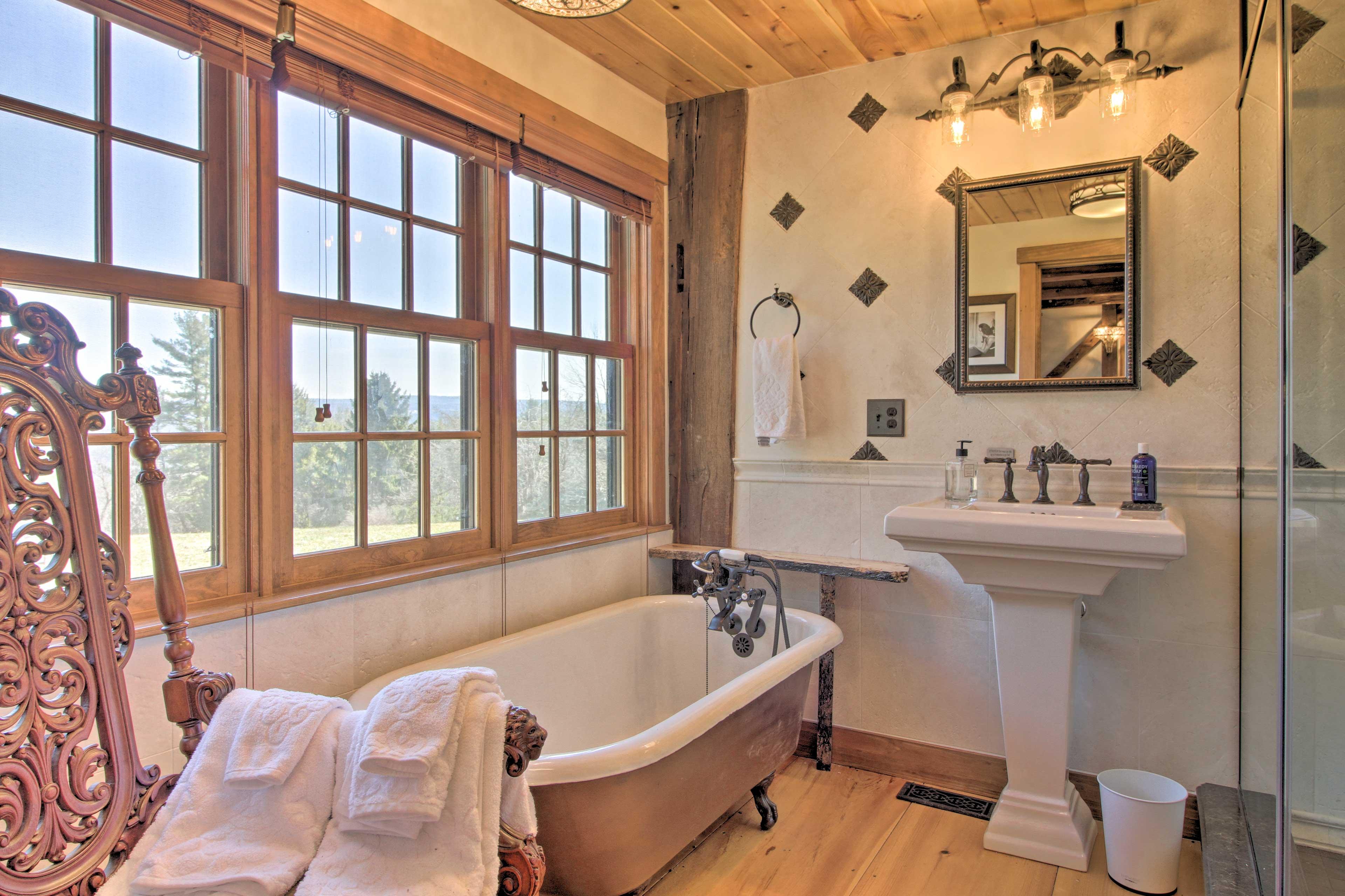 The second bathroom has an original clawfoot tub and Italian-style tiles.