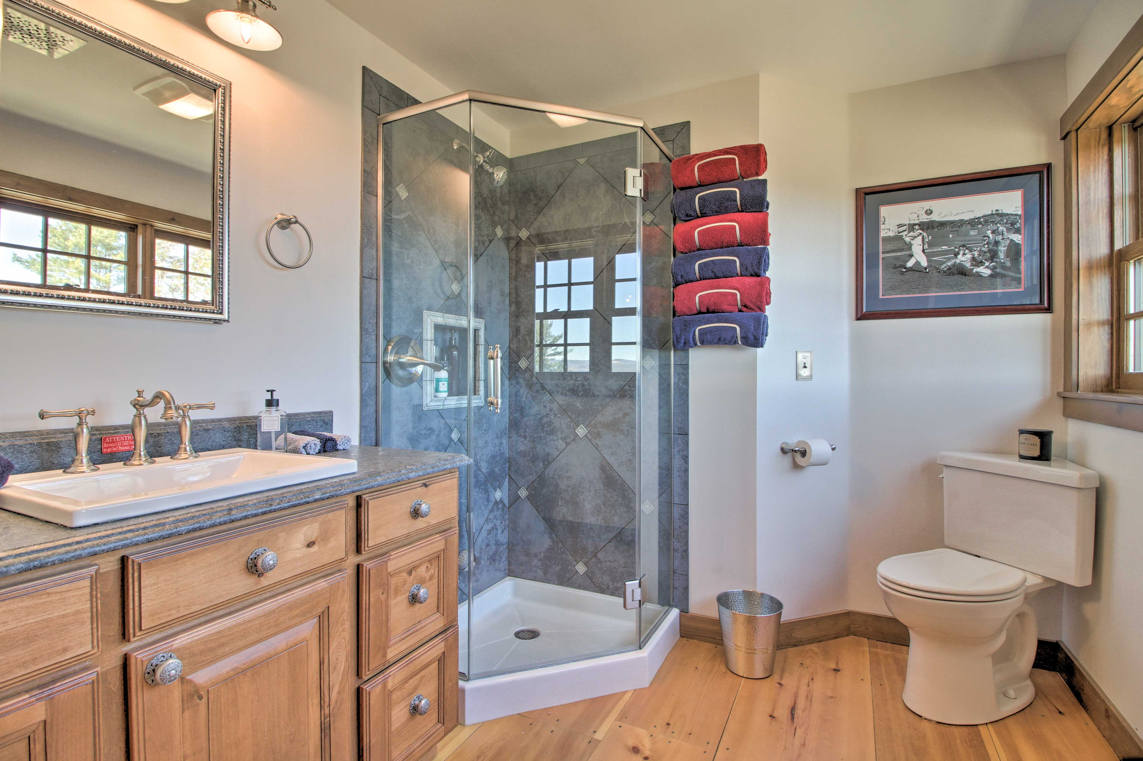 The third bathroom has a walk-in shower and complimentary towels.