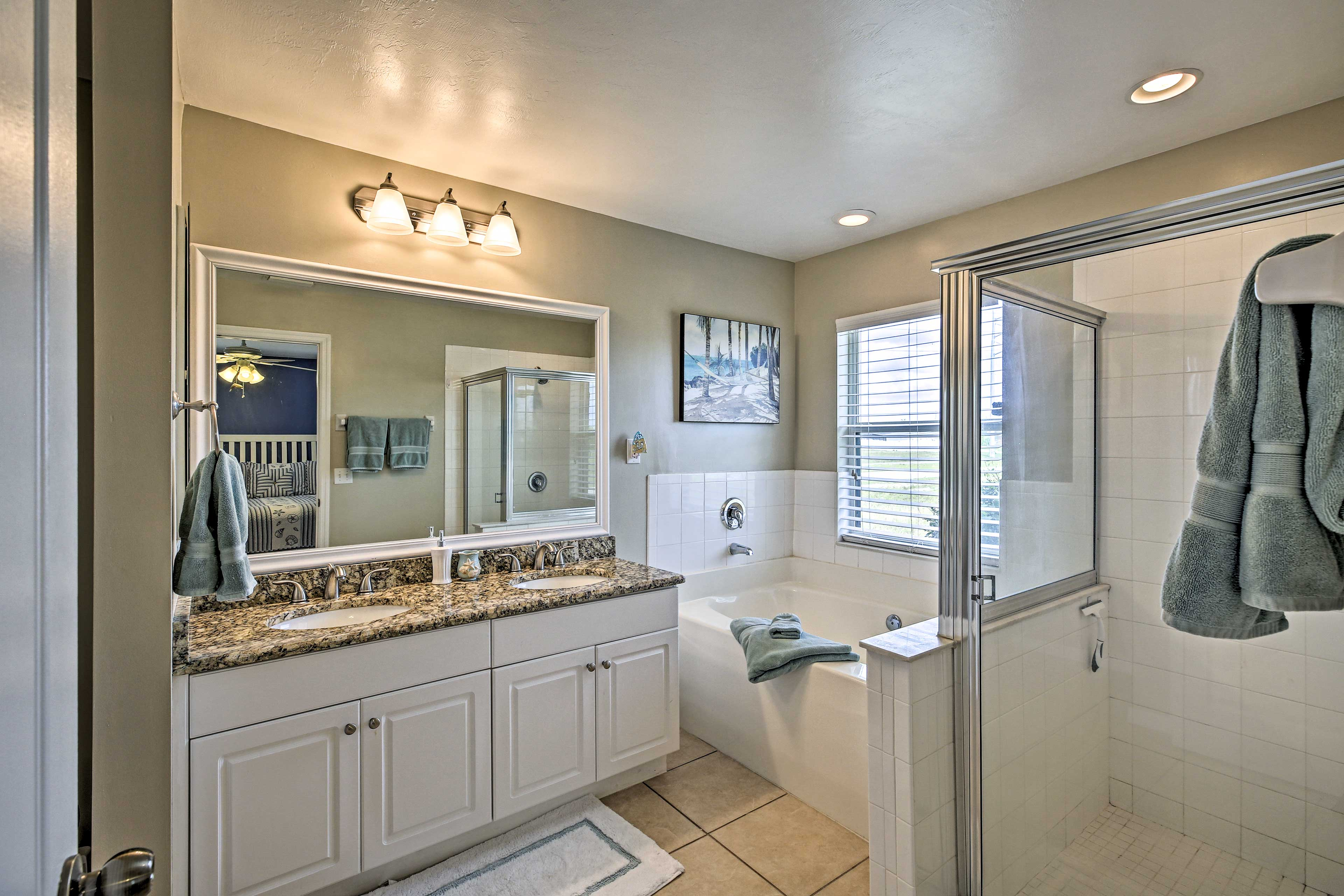 The en-suite bathroom has a walk-in shower and soaking tub.