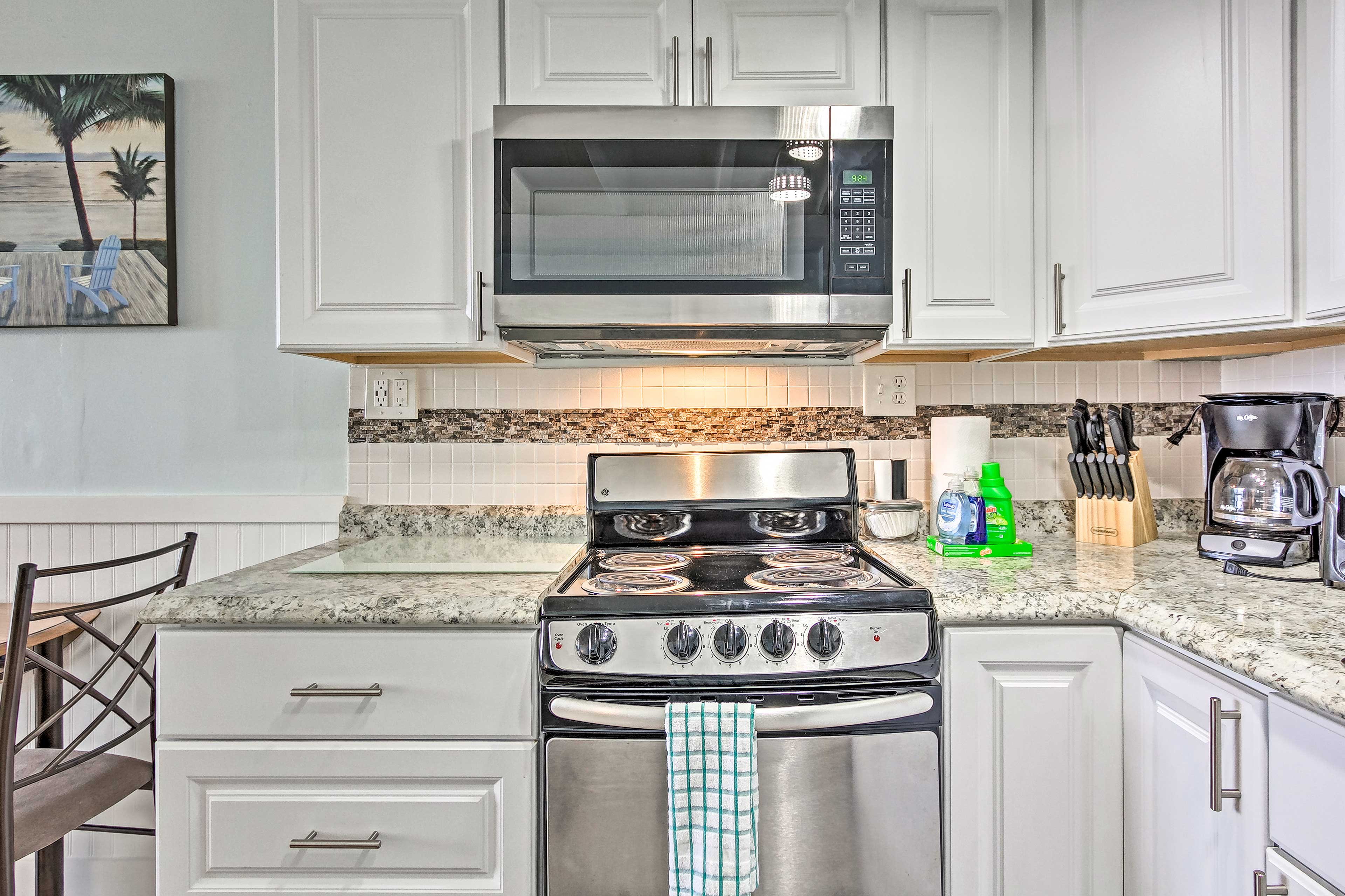 The modern kitchen features stainless steel appliances.