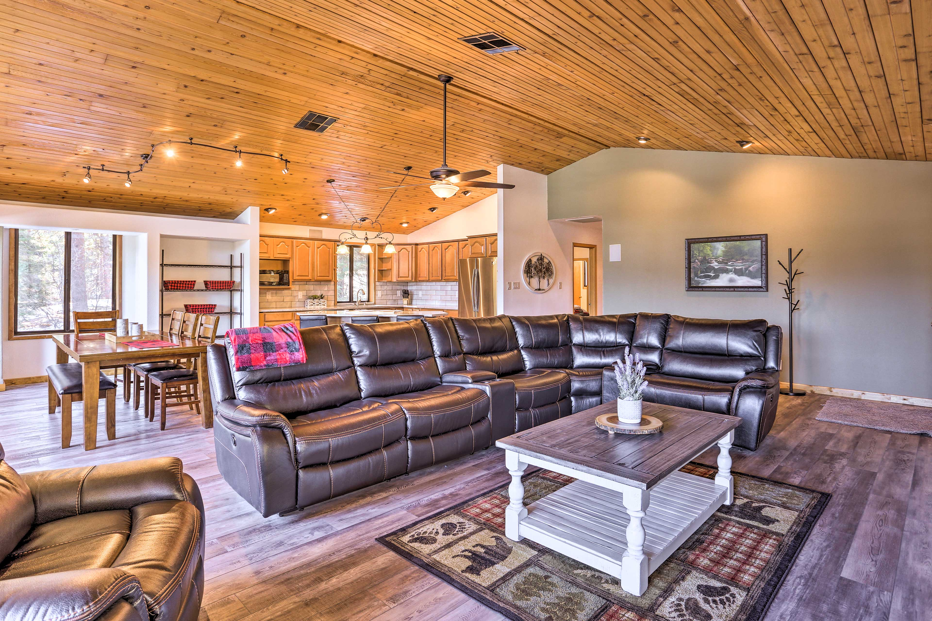 The newly renovated interior features vaulted ceilings and wall-to-wall windows.