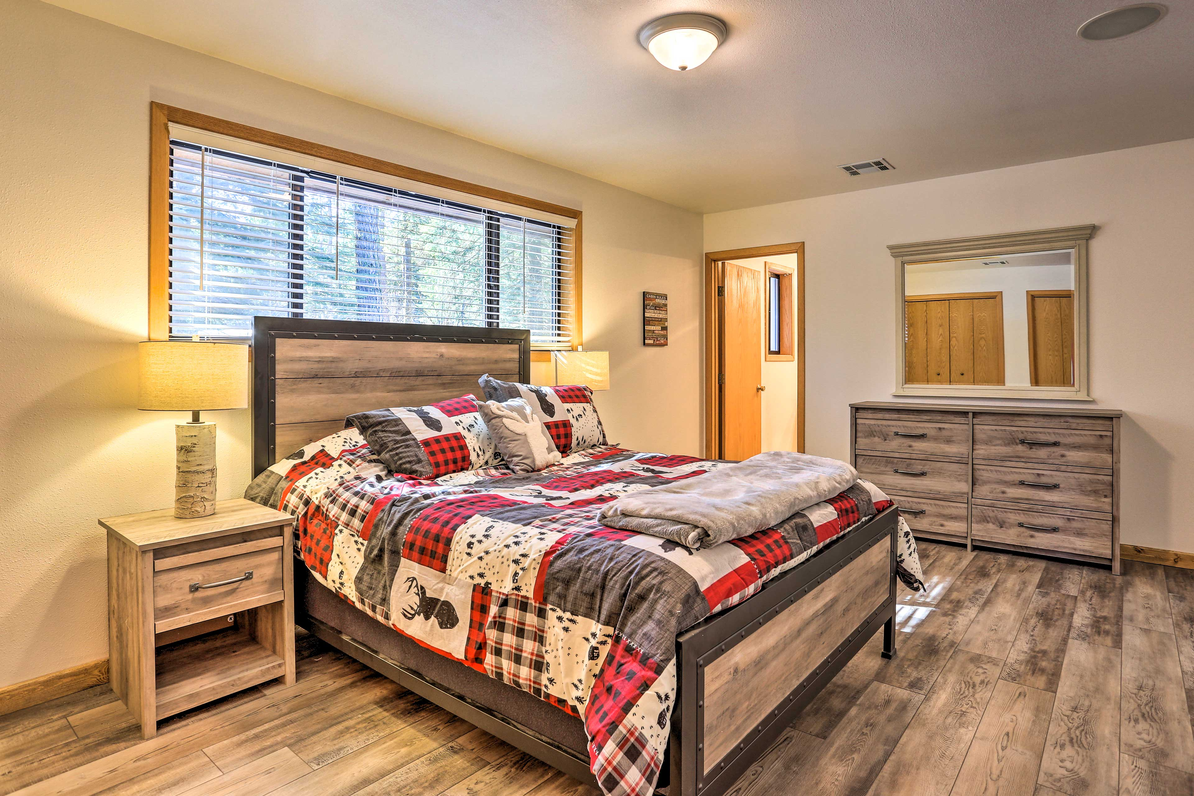 The master bedroom features a queen-sized bed and cabin-style bedding.