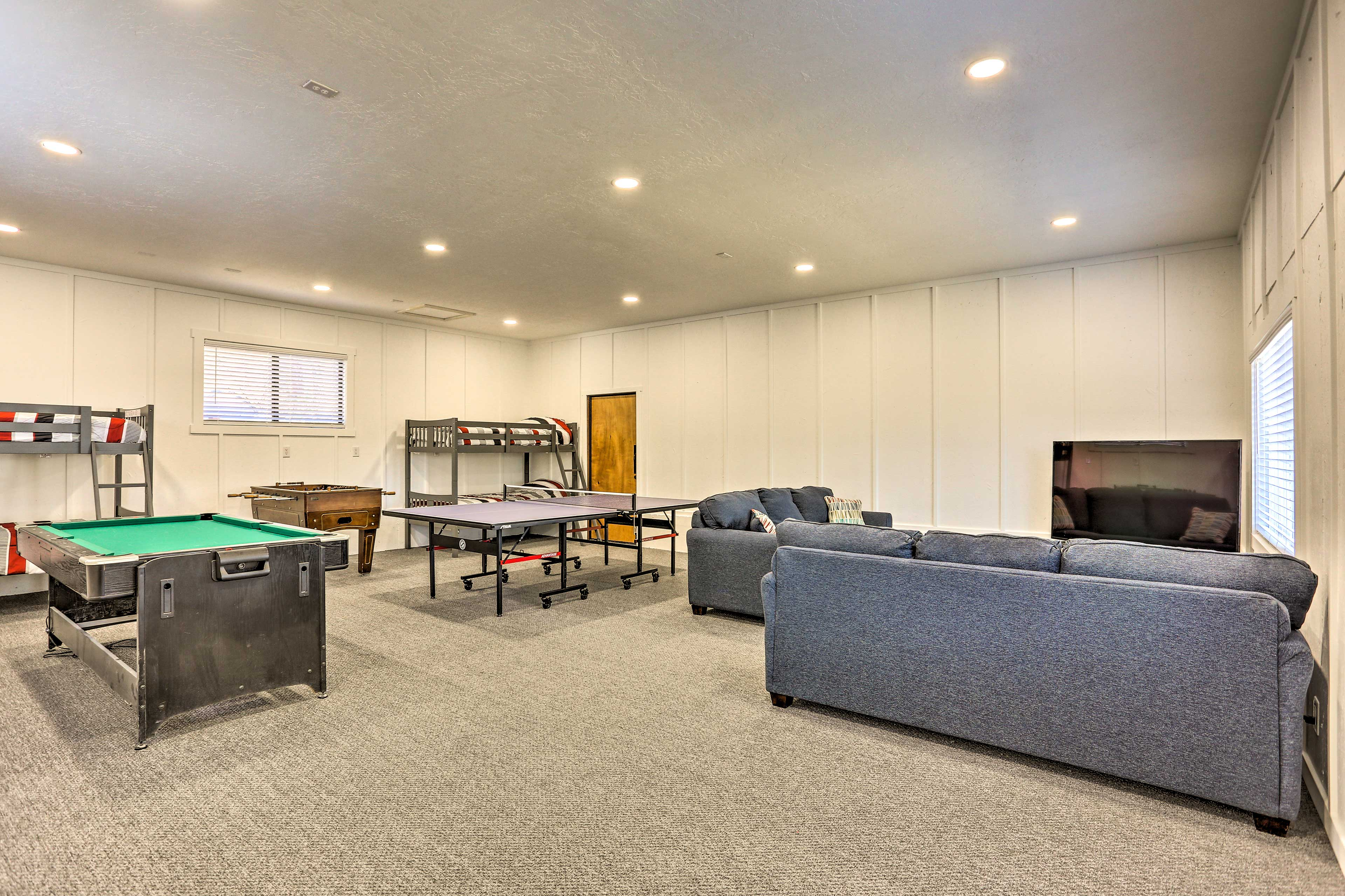 The game room features 2 twin bunk beds and 2 sleeper sofas.