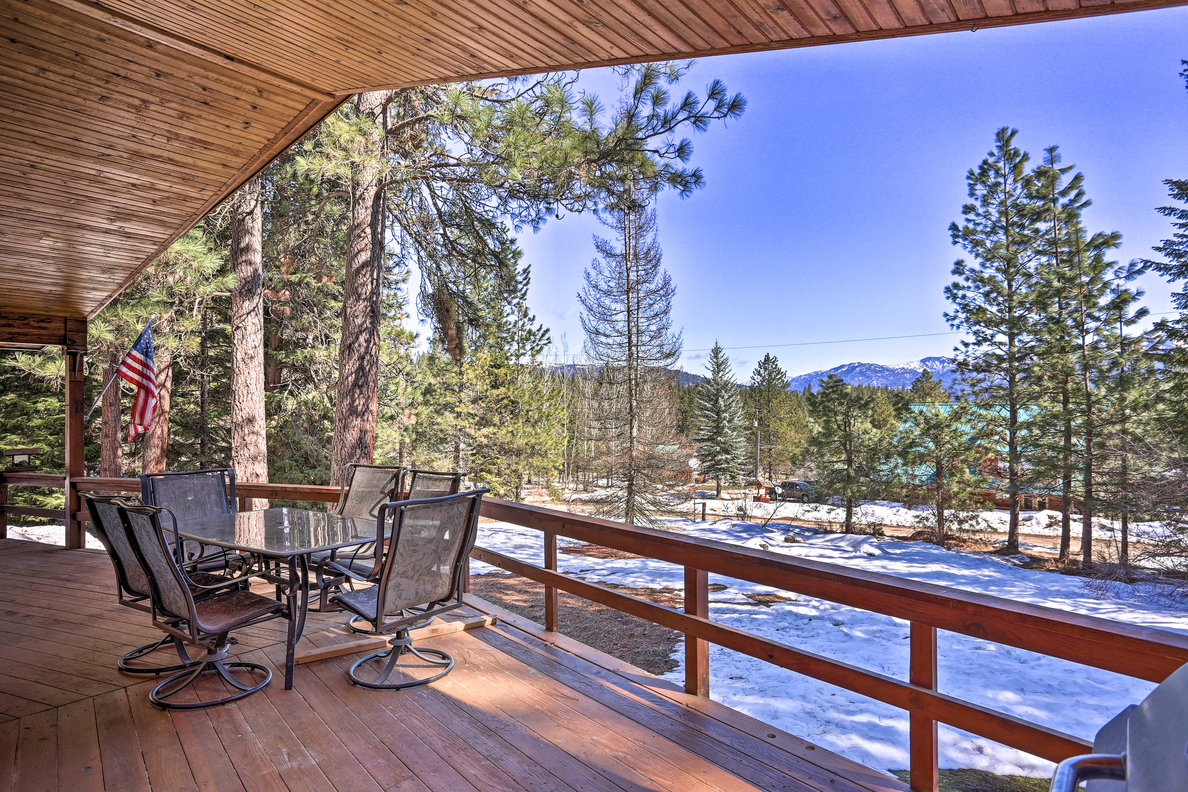 Take dinner on this vacation rental's covered deck with a view of the mountains!