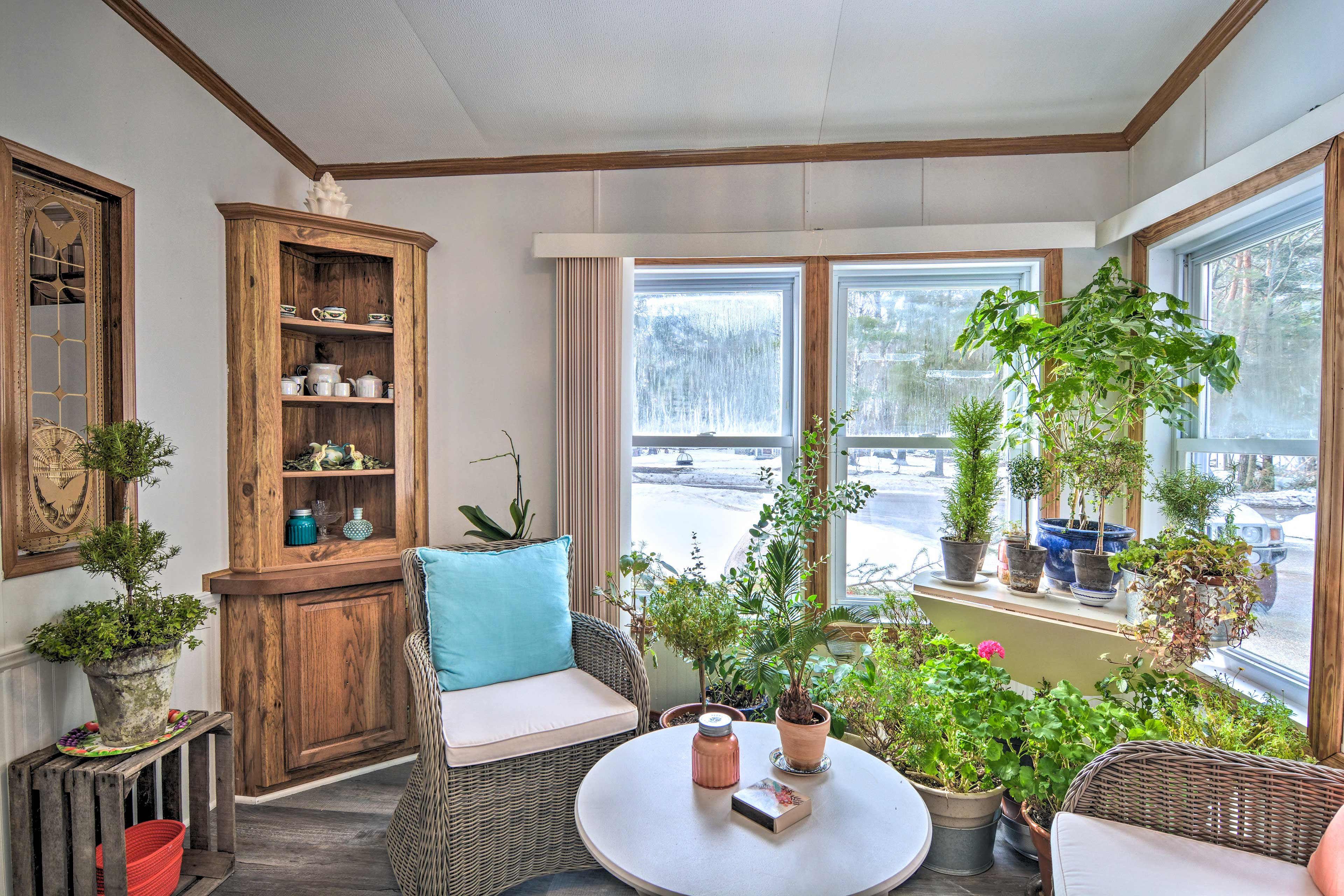 Catch up on some light reading in the light-filled sunroom.