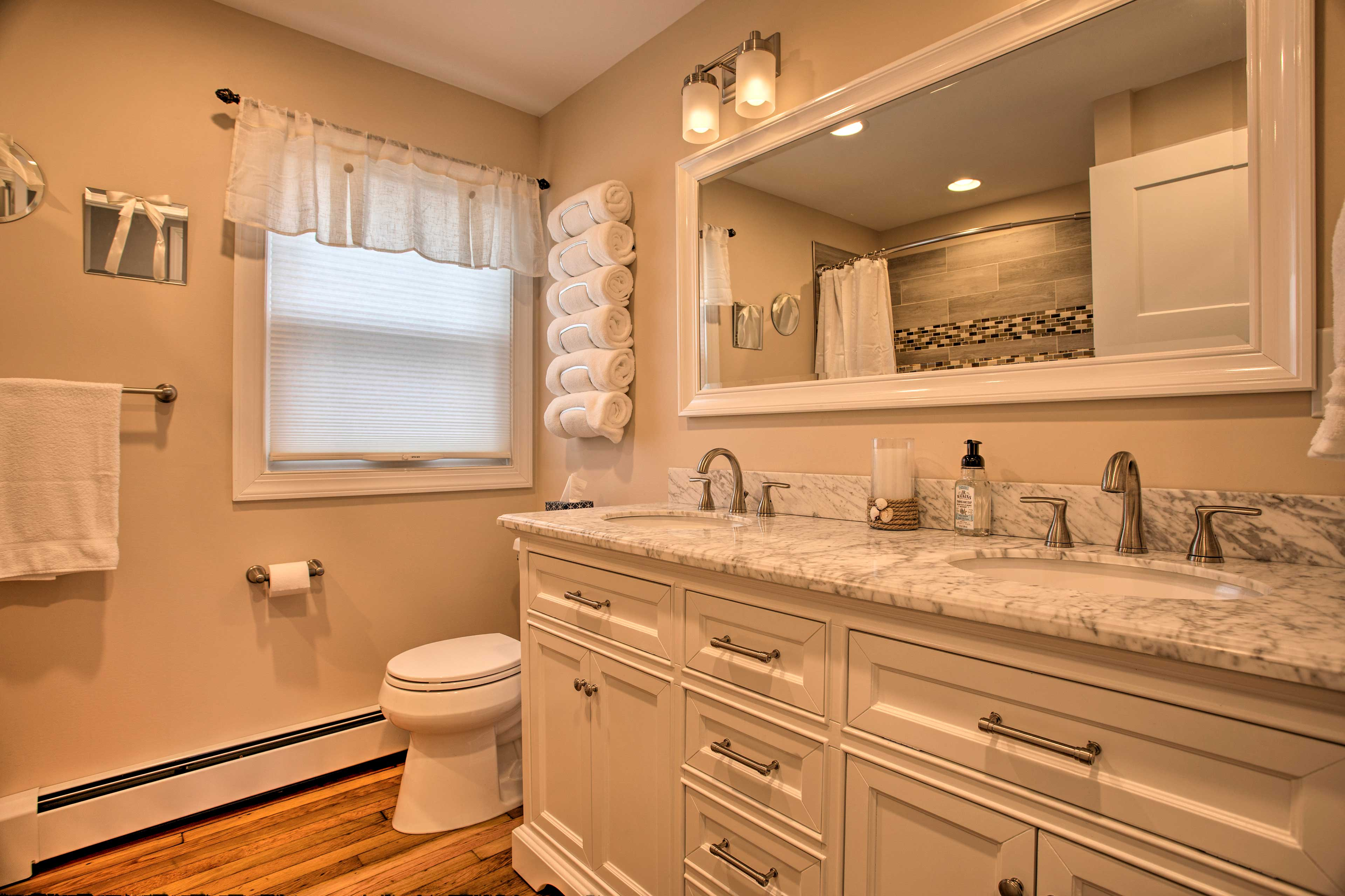 The master bathroom features Jack-and-Jill sinks and a shower/tub combo.