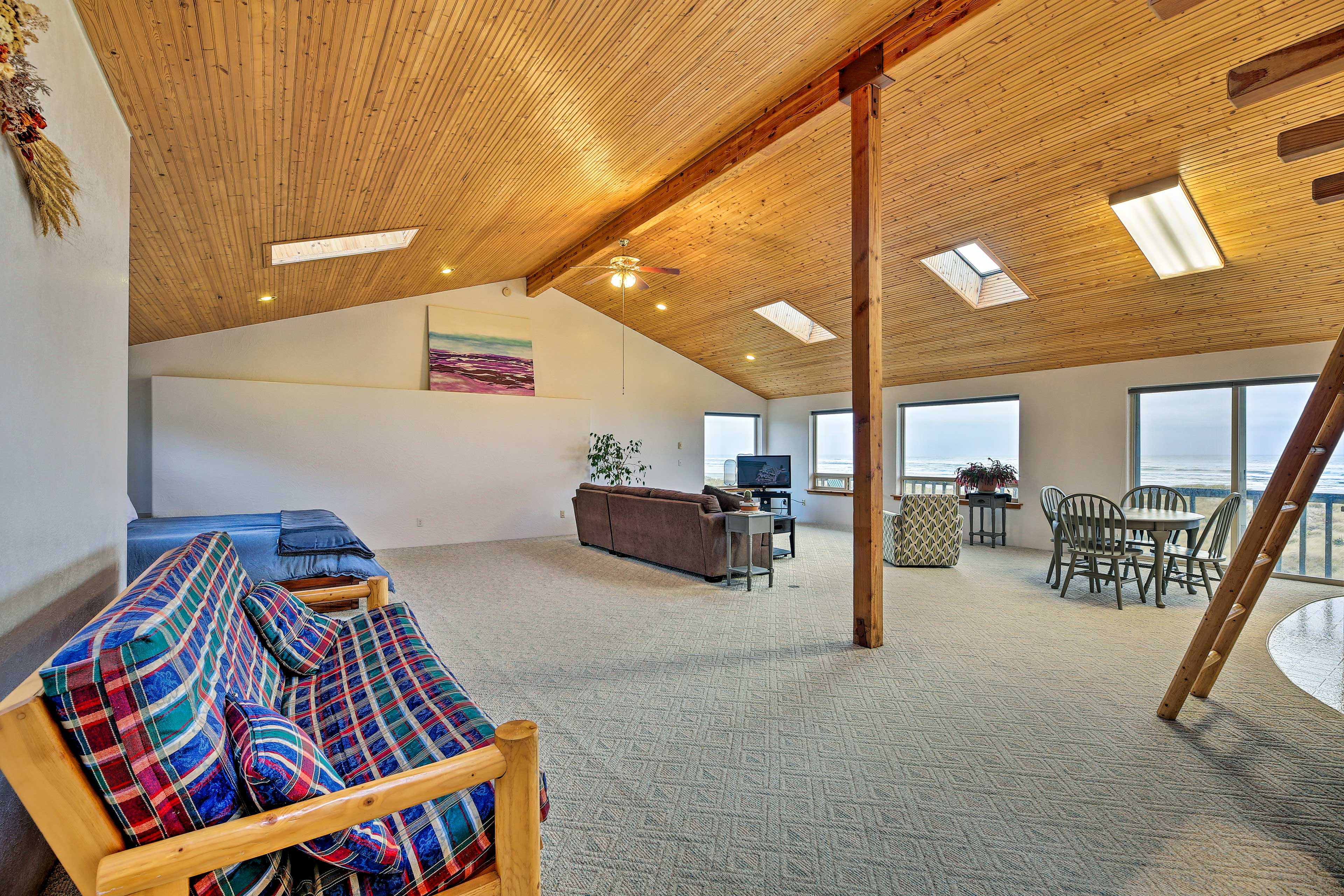Cathedral ceilings and skylights make for an open, bright space.