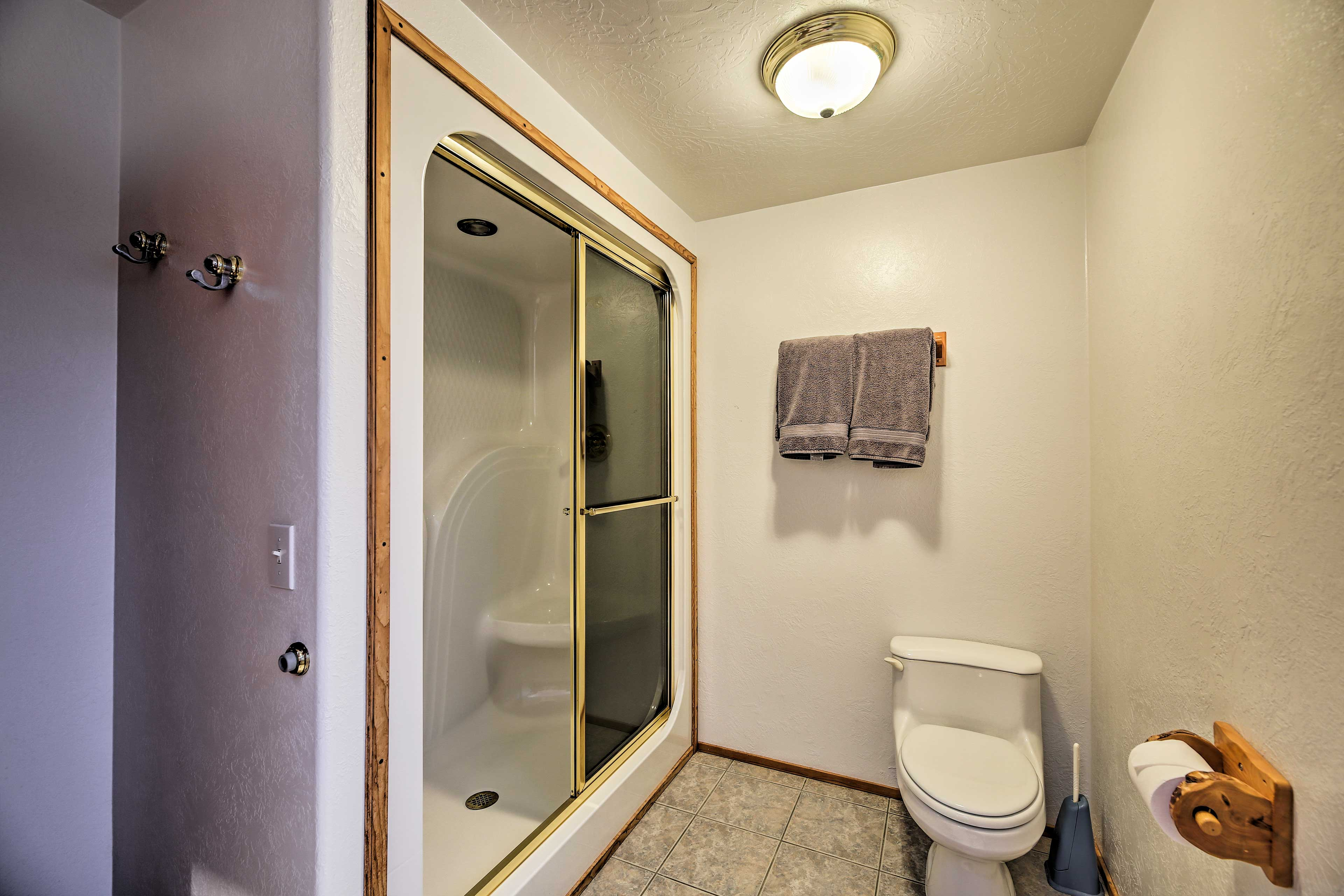 Wash the sand between your toes in the walk-in shower.