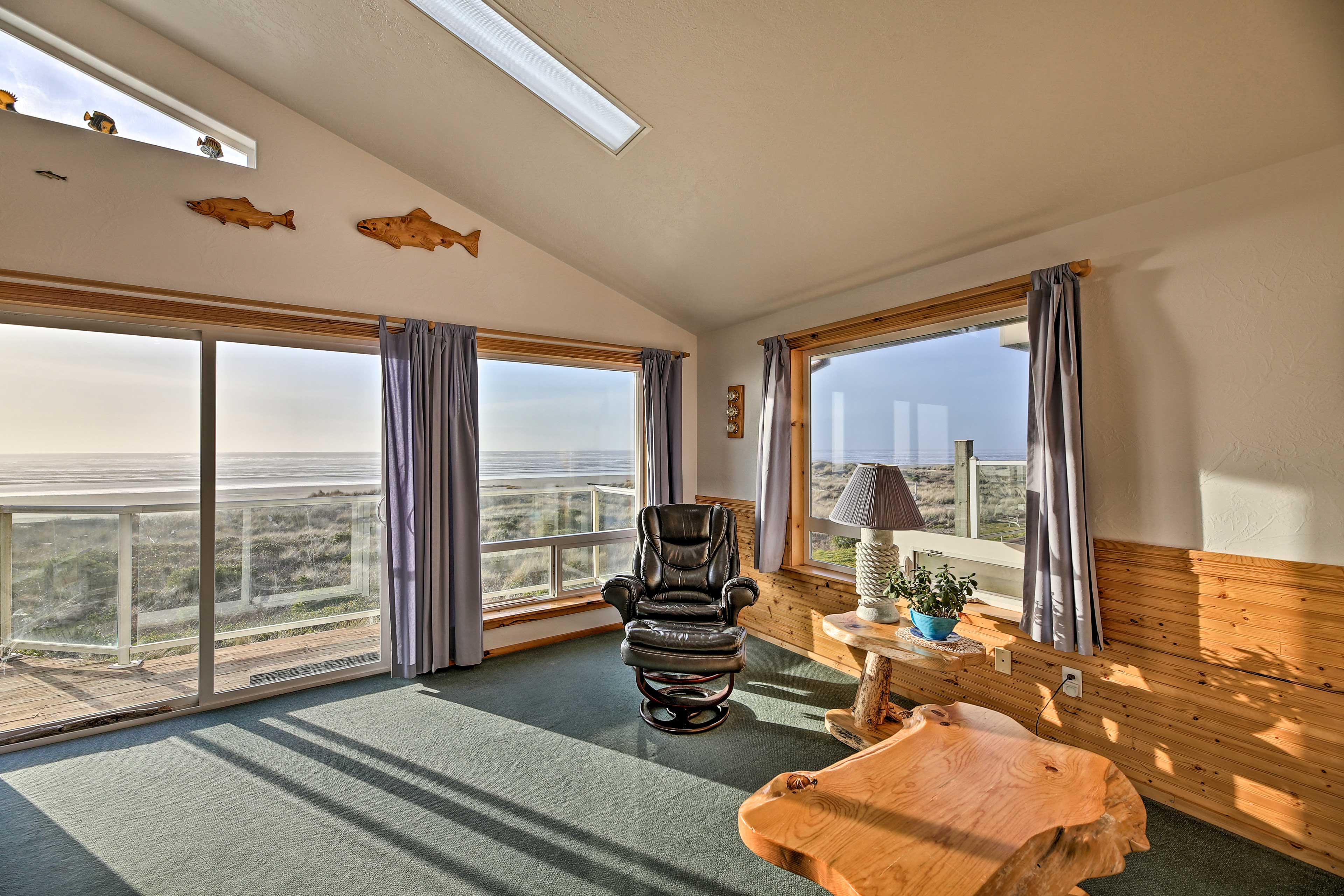 View the Pacific Ocean through the large windows throughout this home.