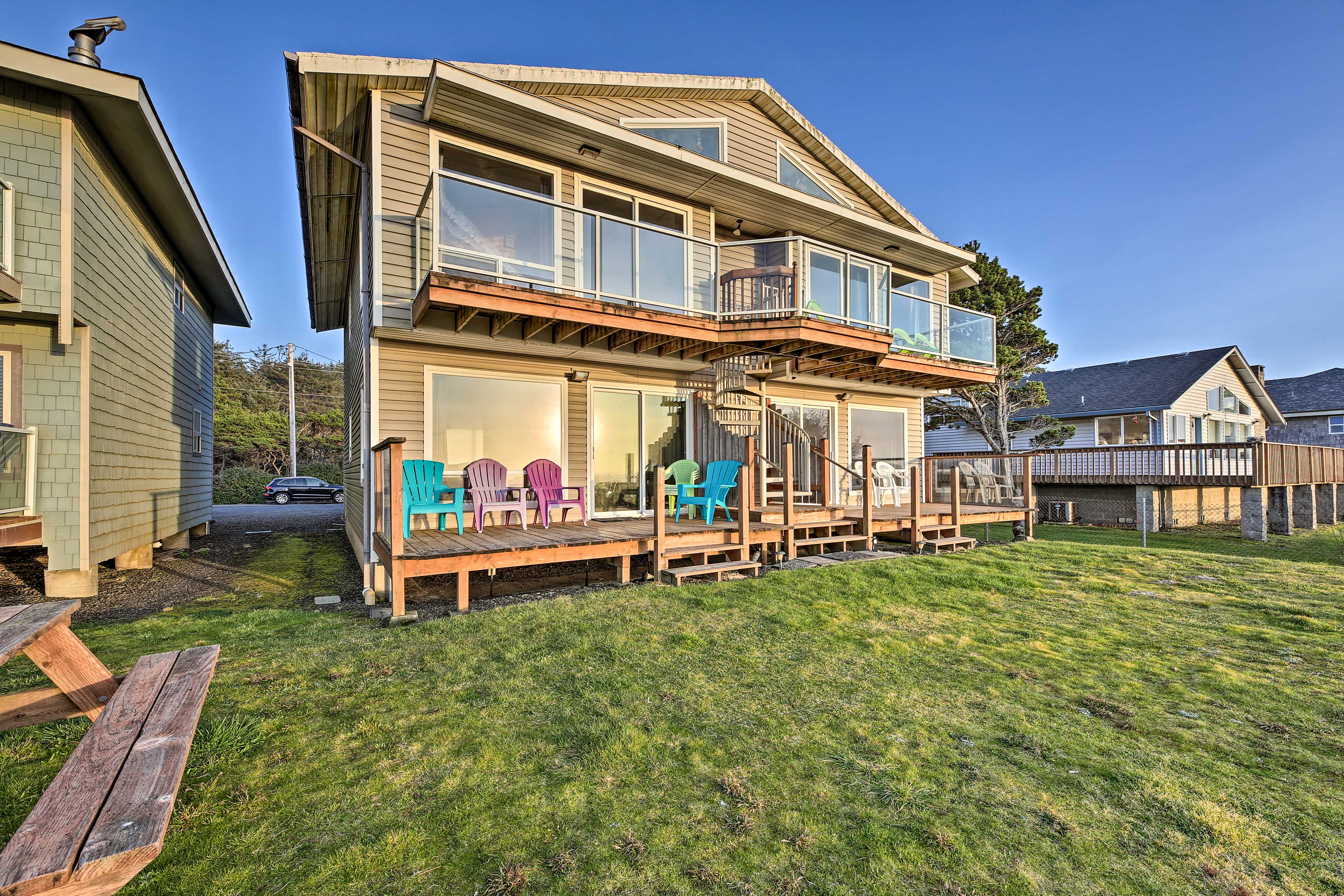 Watch sunset from the back balcony or deck off this vacation rental.