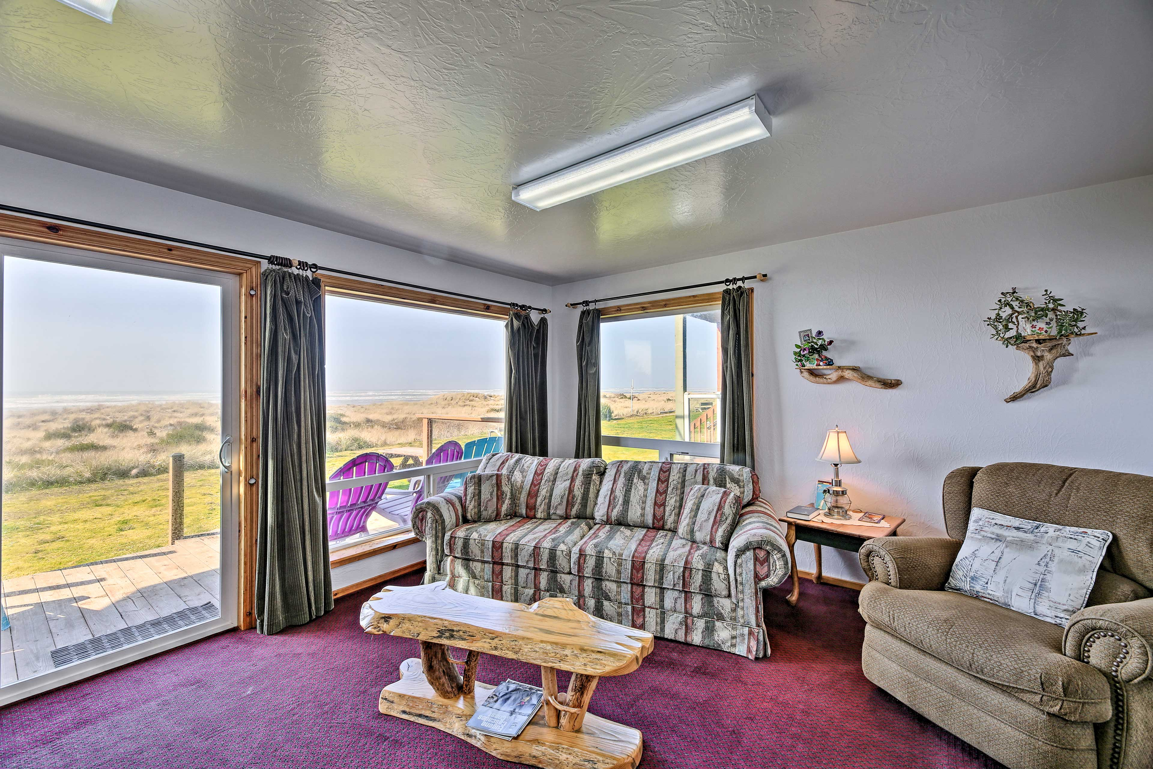 This home has large, picture windows with a view of the sea!
