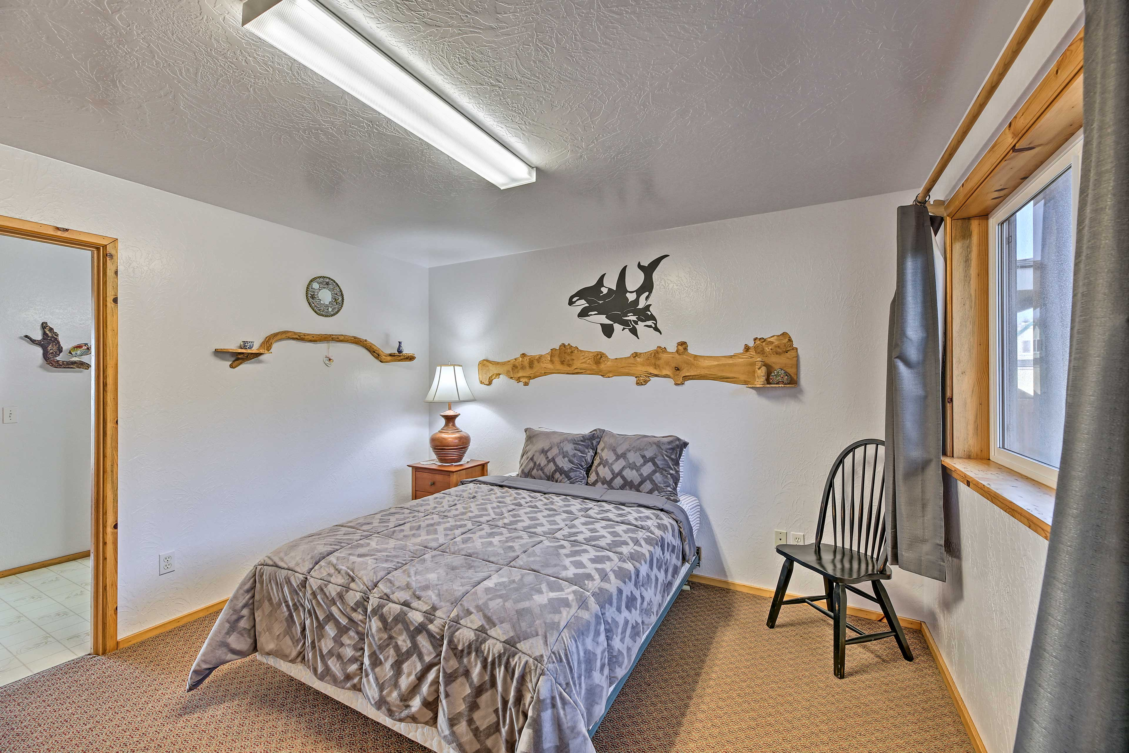 The master bedroom has tasteful raw wood shelves.