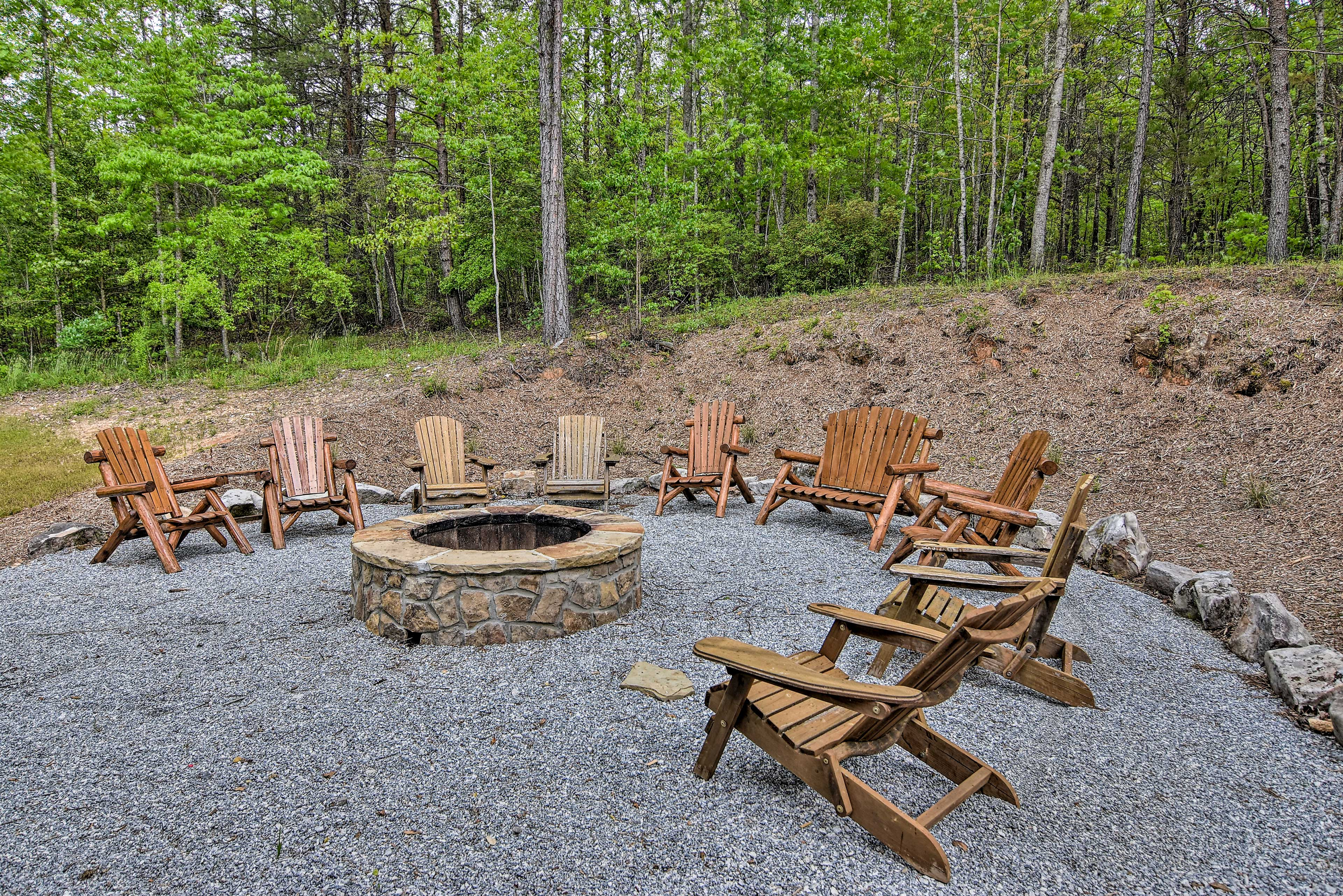 The 3-bed, 2-bath home offers outdoor living space including a fire pit.