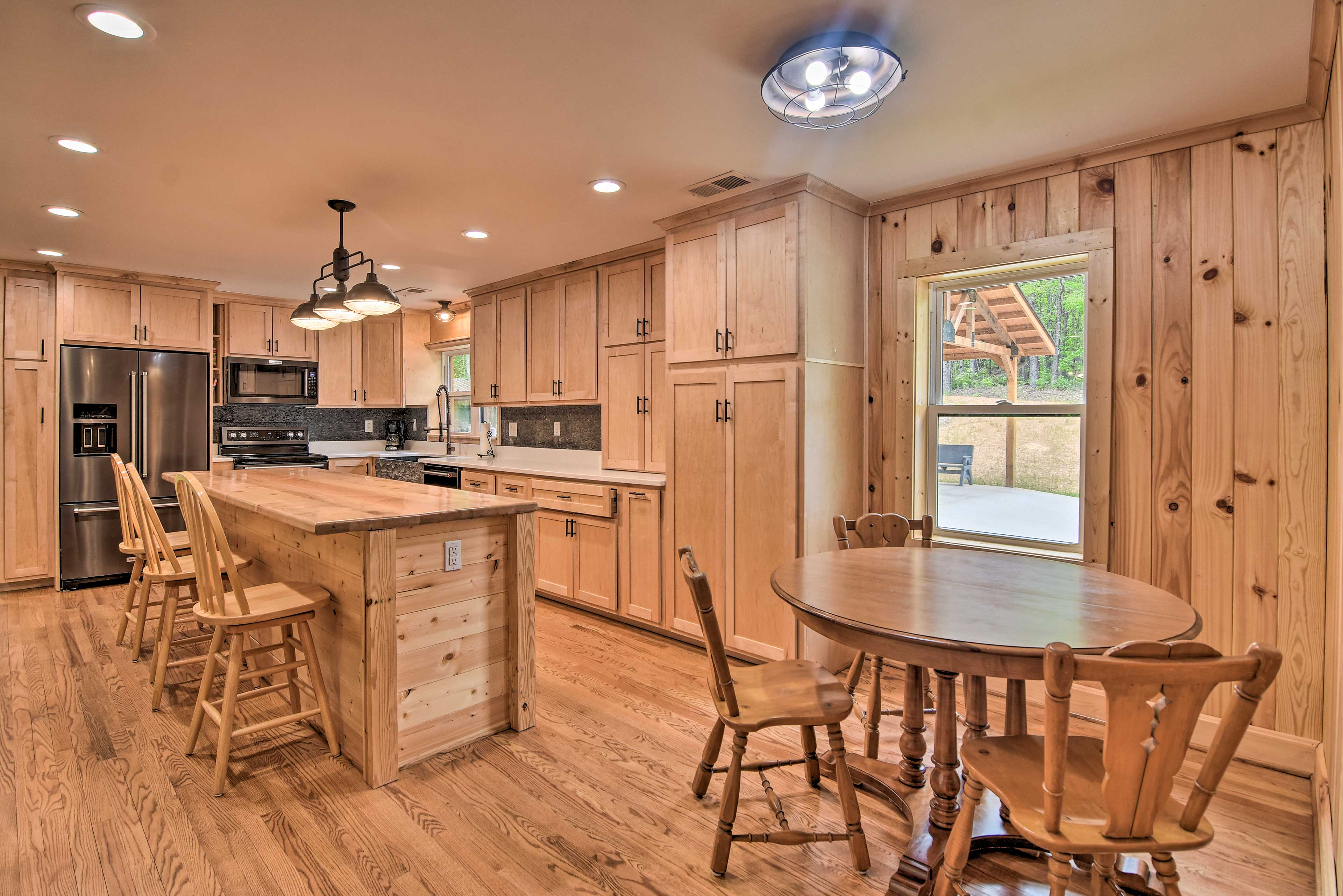 The kitchen boasts a dishwasher and stainless steel appliances.