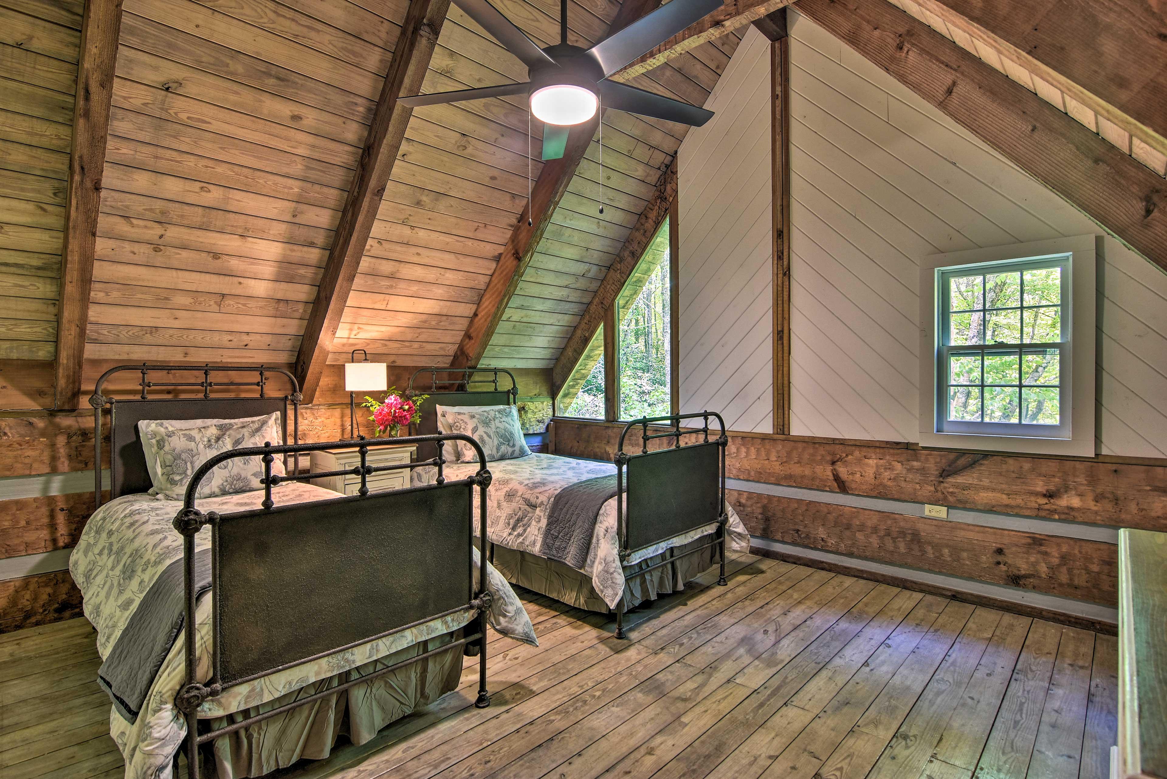 This stylish room sleeps 2 with twin beds.