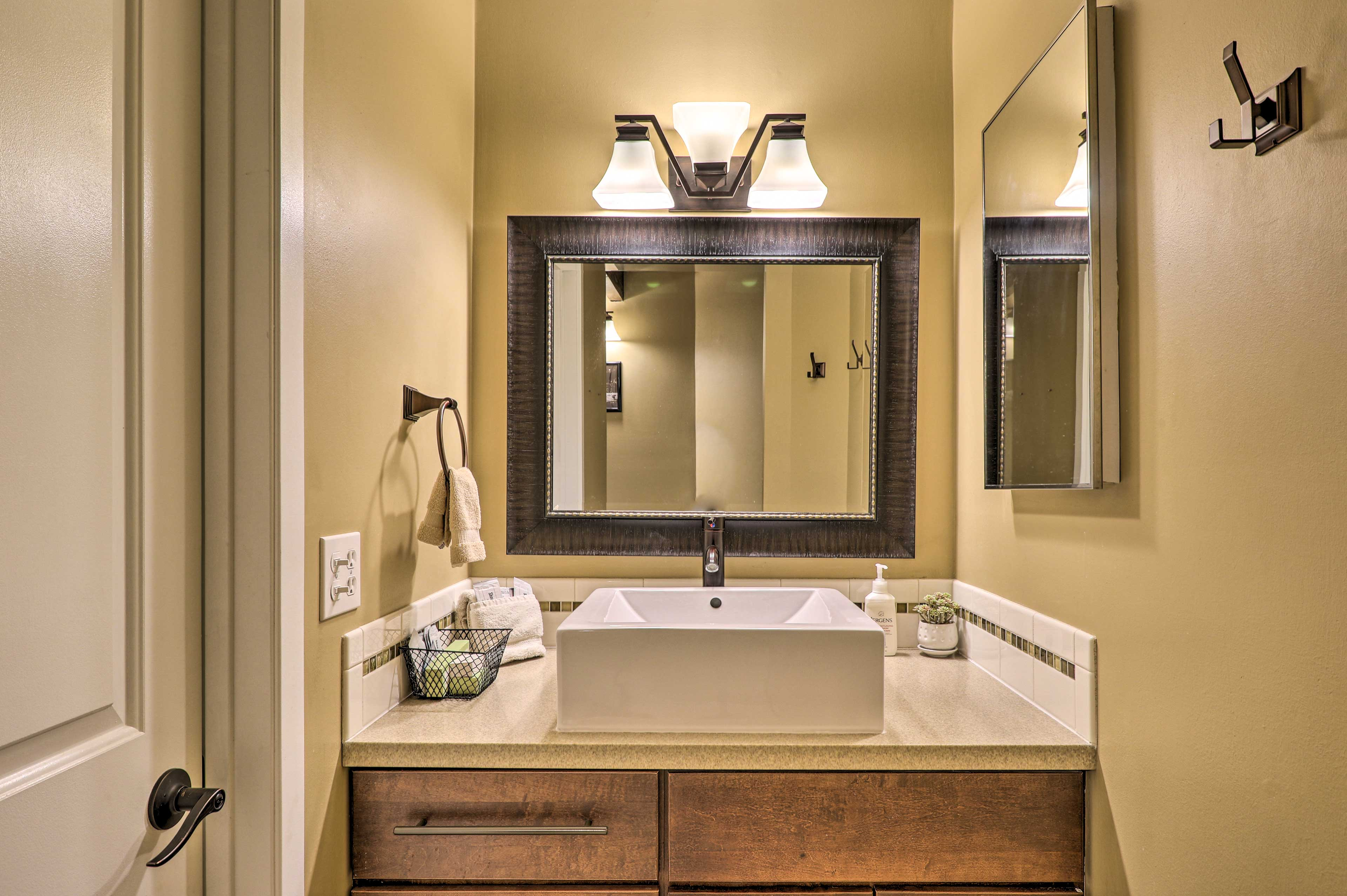 Vessel sinks add a touch of modernity to the bathroom.
