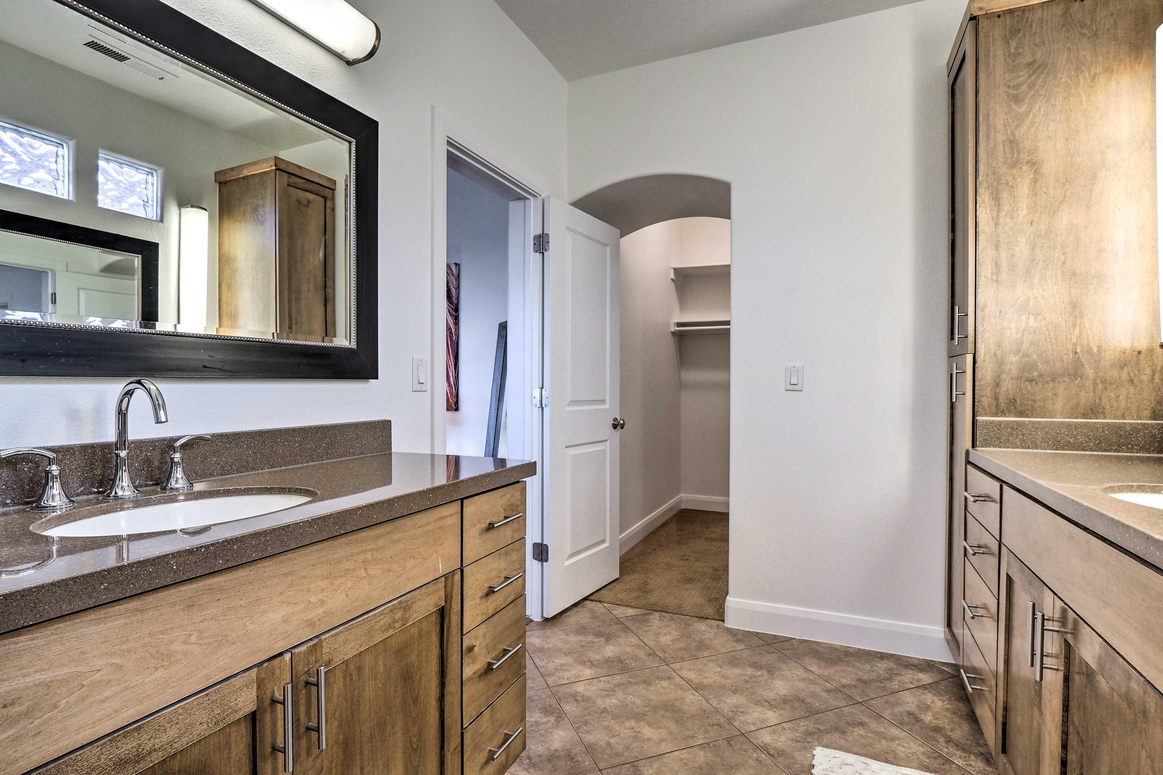 The en-suite bathroom has double vanities.