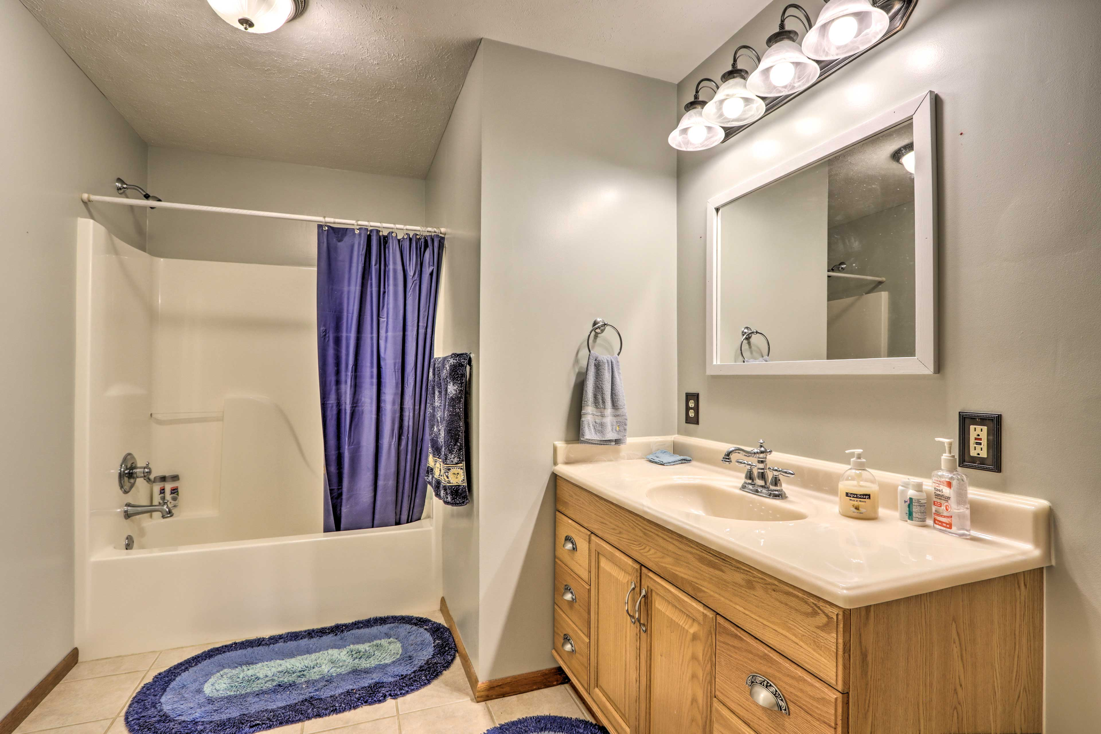 This bathroom is equipped with a shower/tub combo.