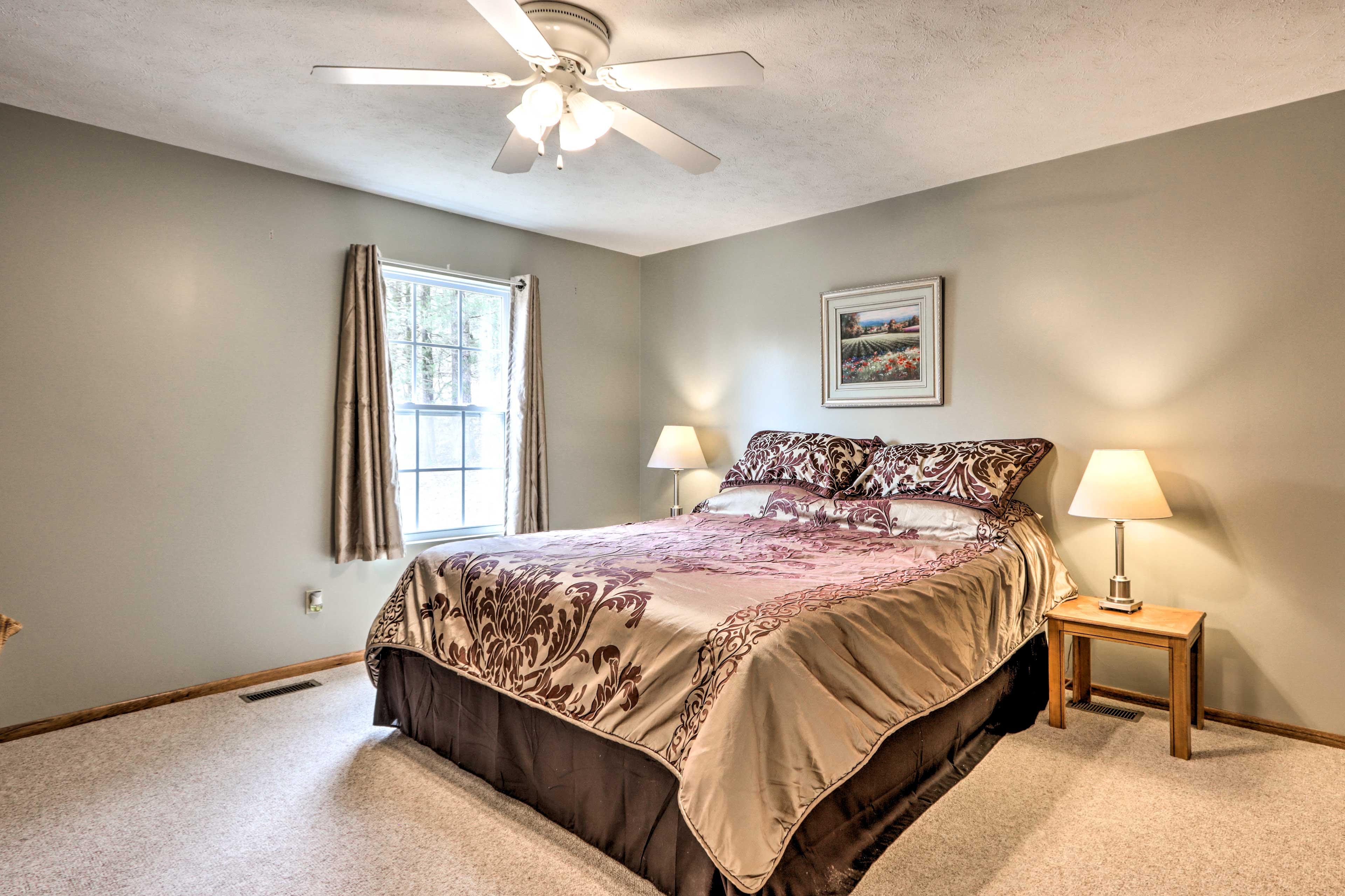 There is a king bed in the master bedroom.