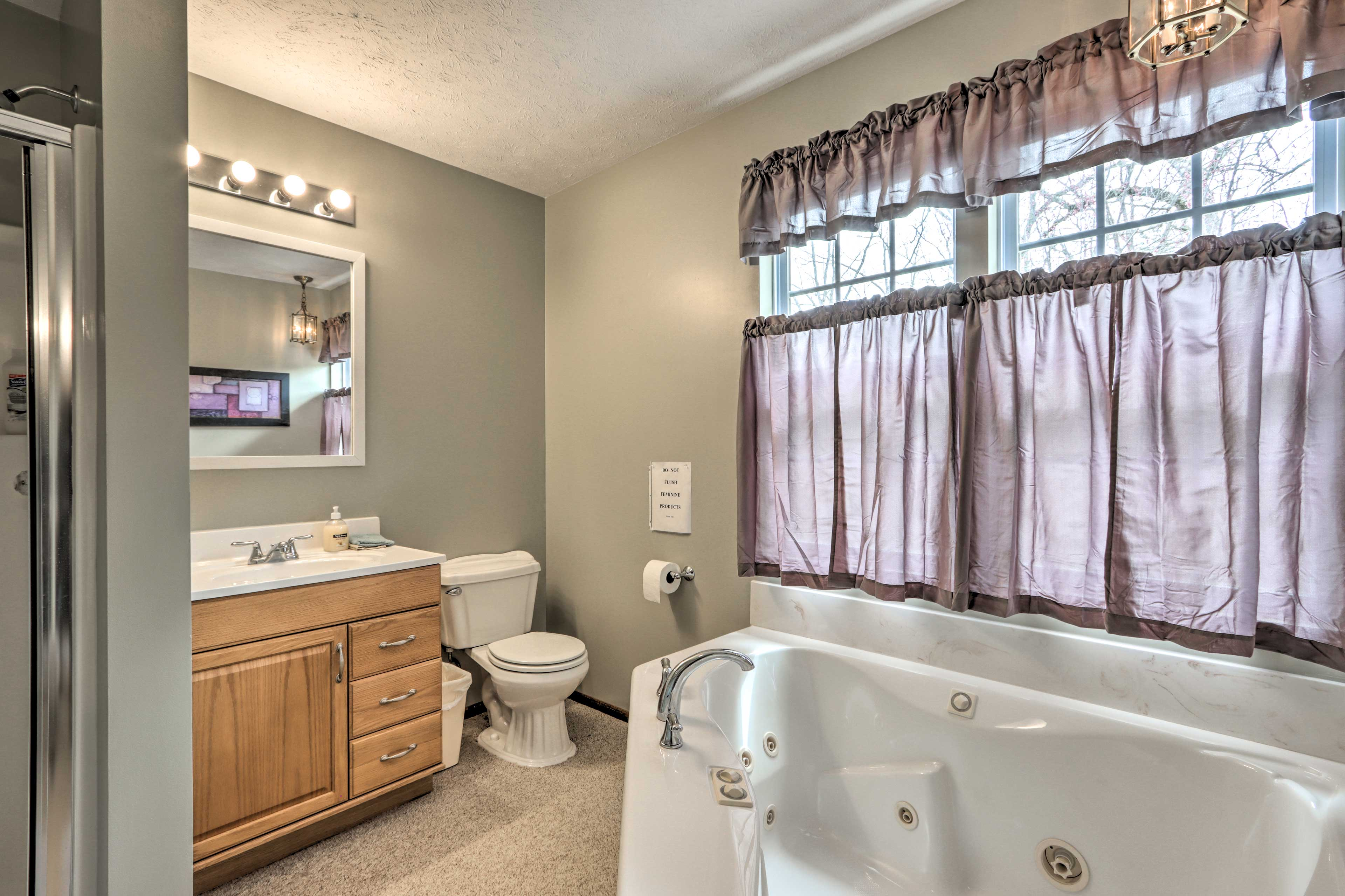 The en-suite bathroom boasts a jetted tub.