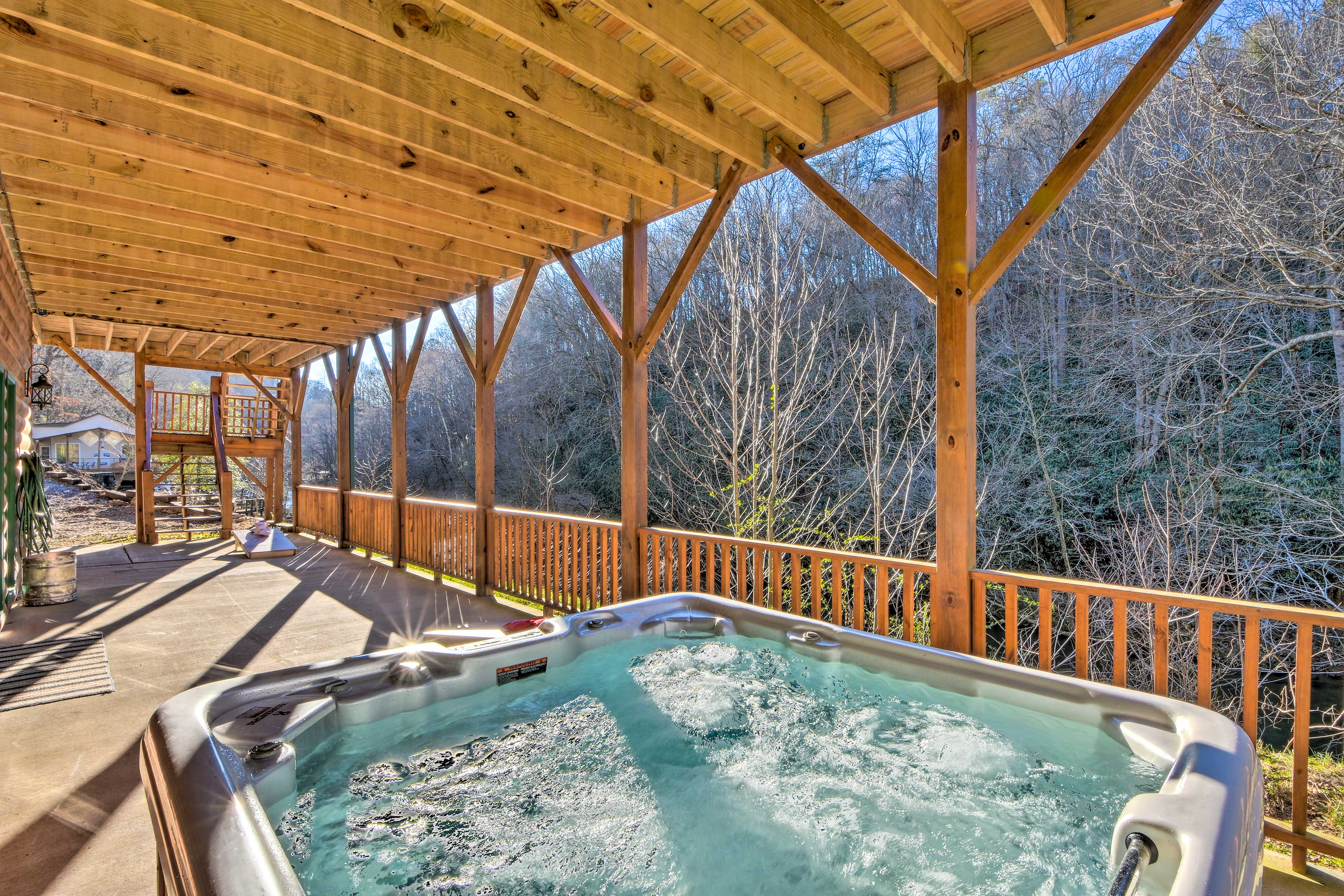 Your riverfront reprieve awaits at this rustic Marble cabin!