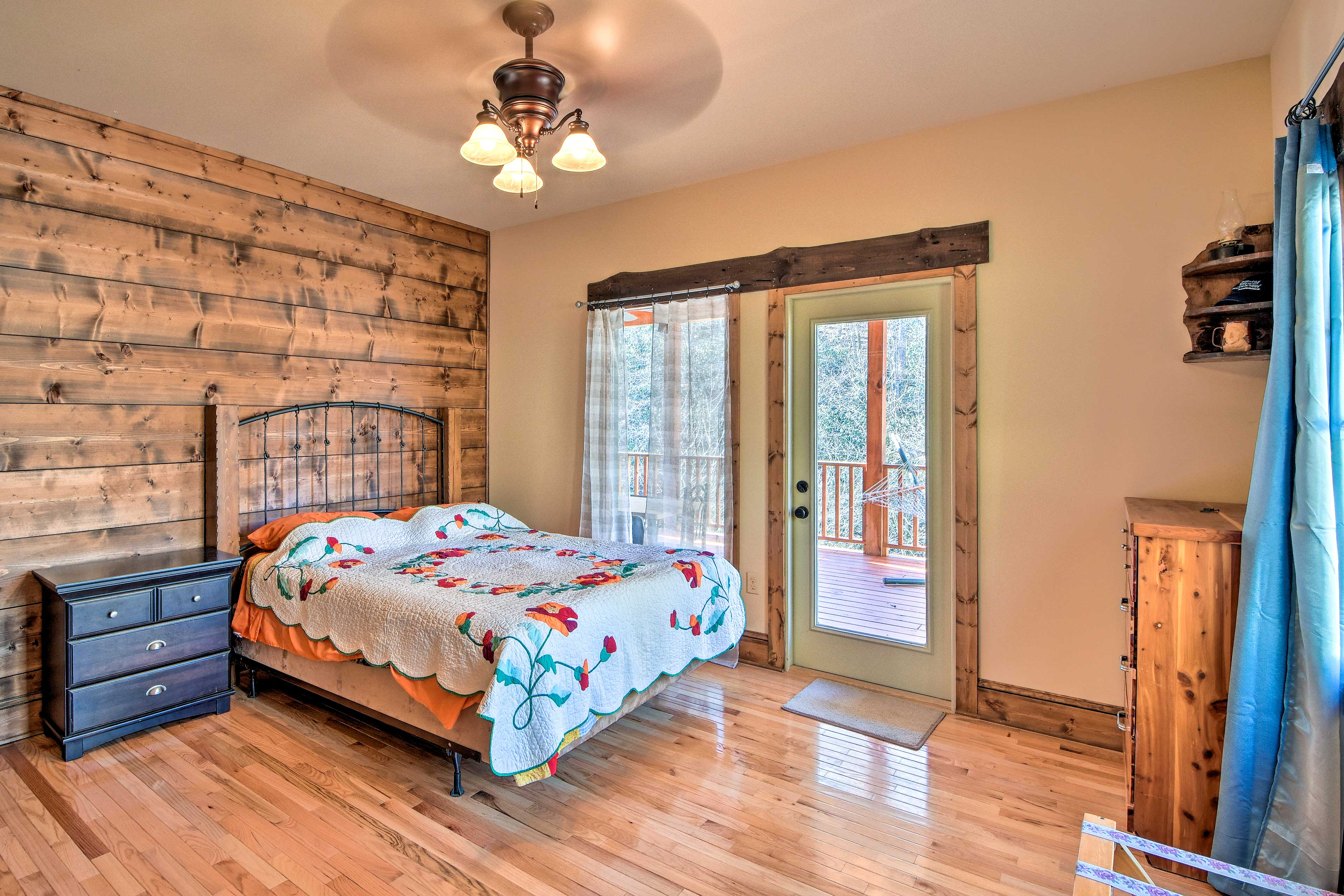 Come evening, retire to this spacious master bedroom.