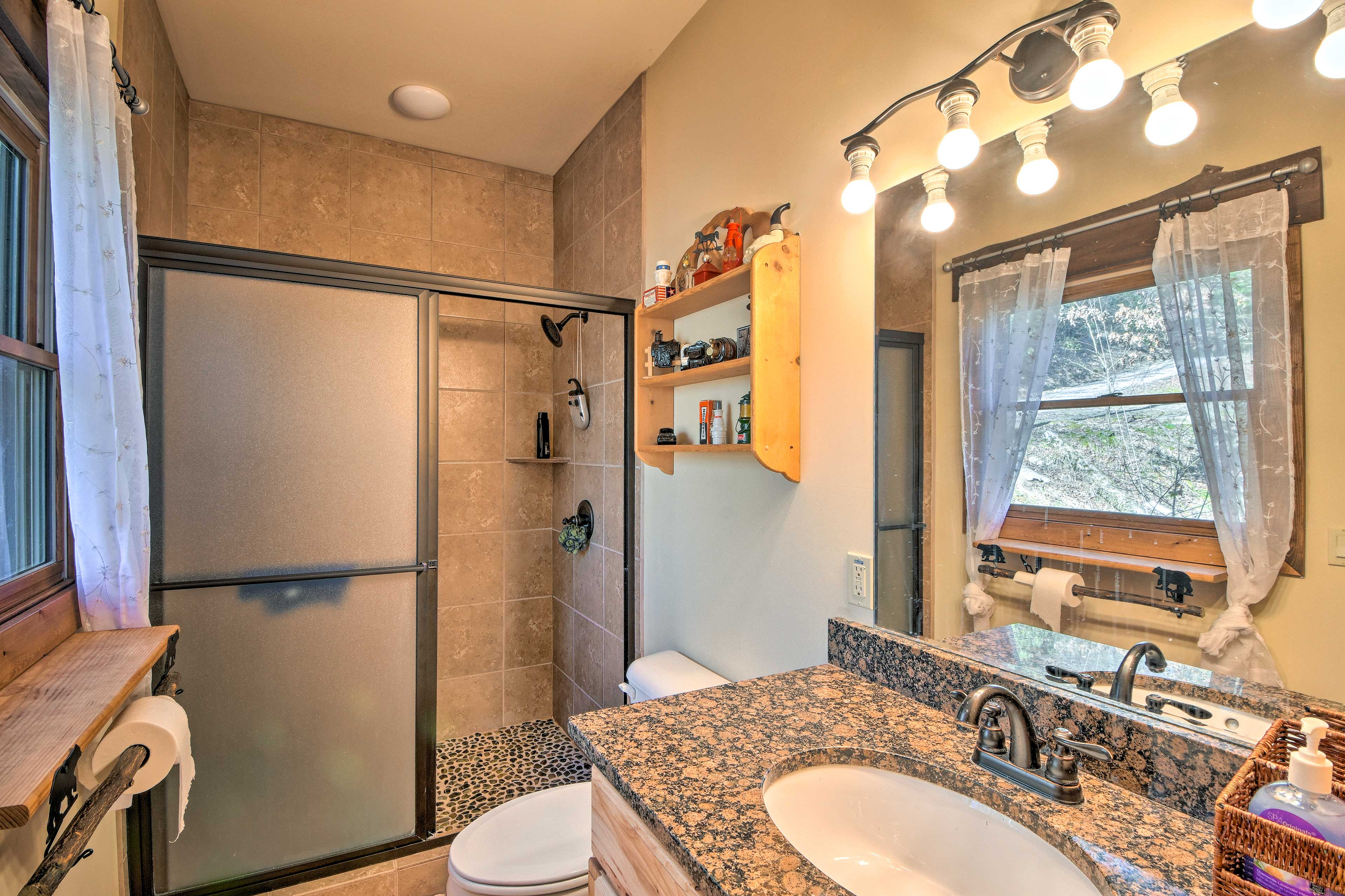 Rinse off the river in this step-in shower.