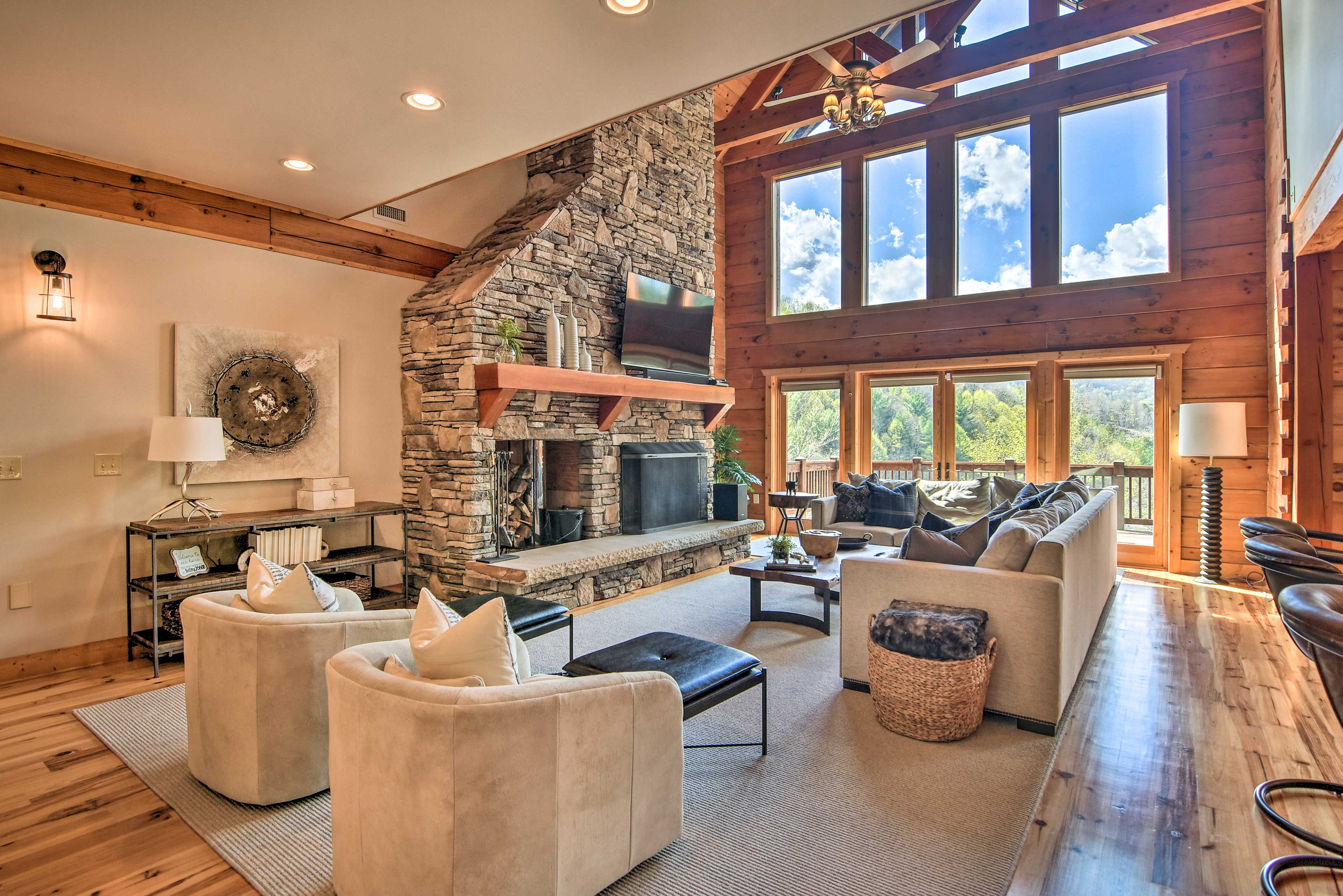 Towering cathedral ceilings & picture windows frame the living space.