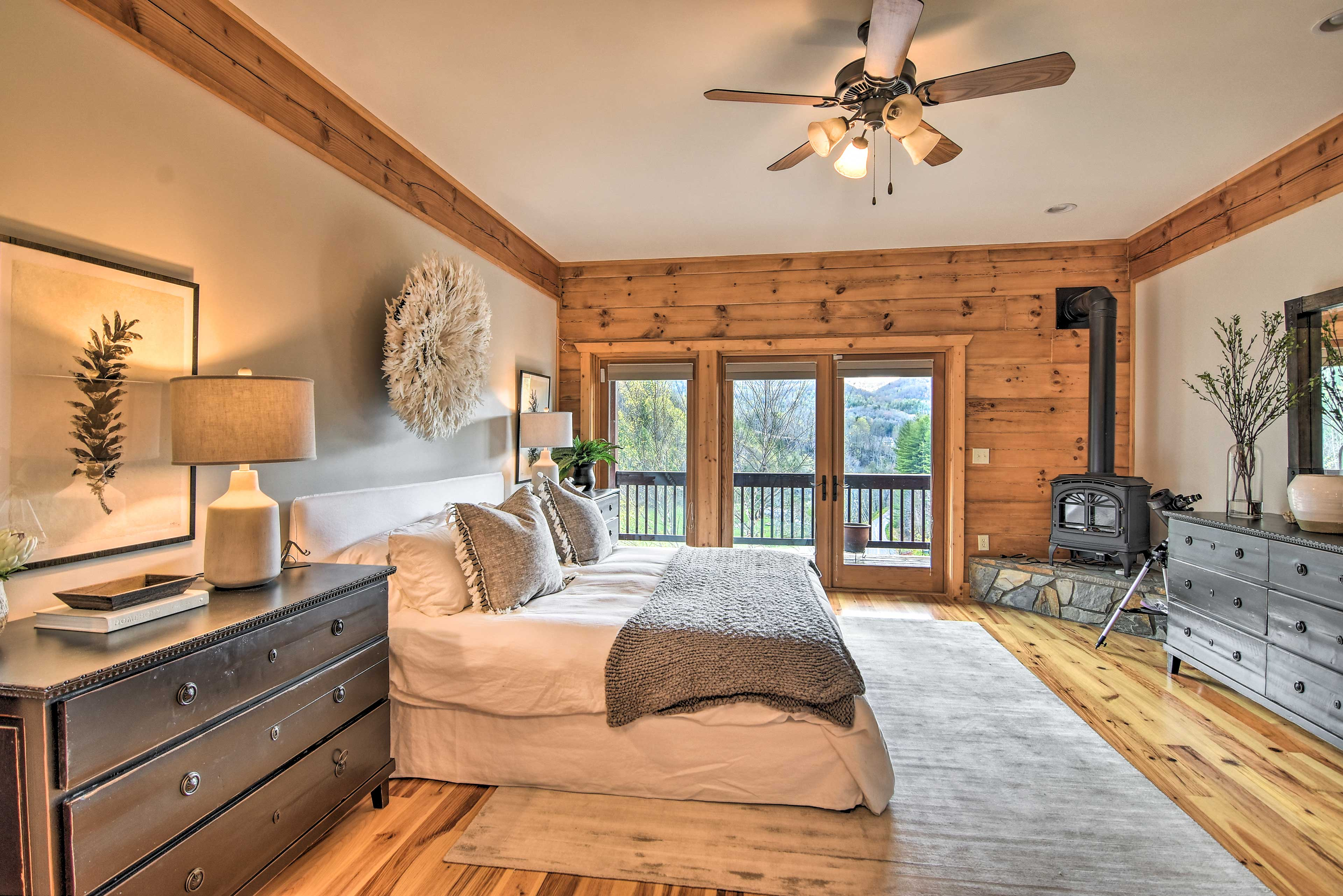 The master suite is equipped with a fireplace & direct deck access.