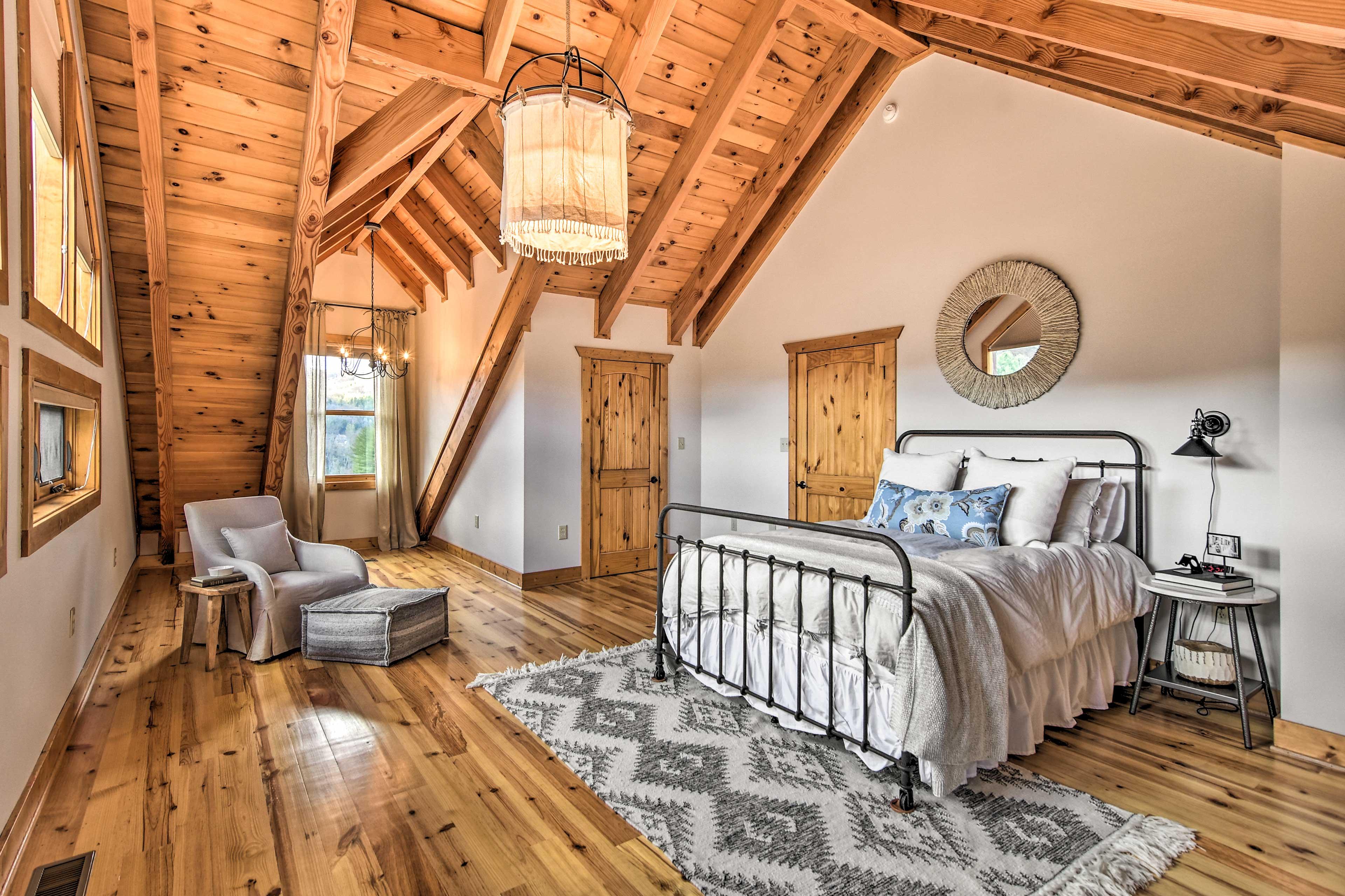 Sleek hardwood floors & ceilings give the home a cabin-like atmosphere.
