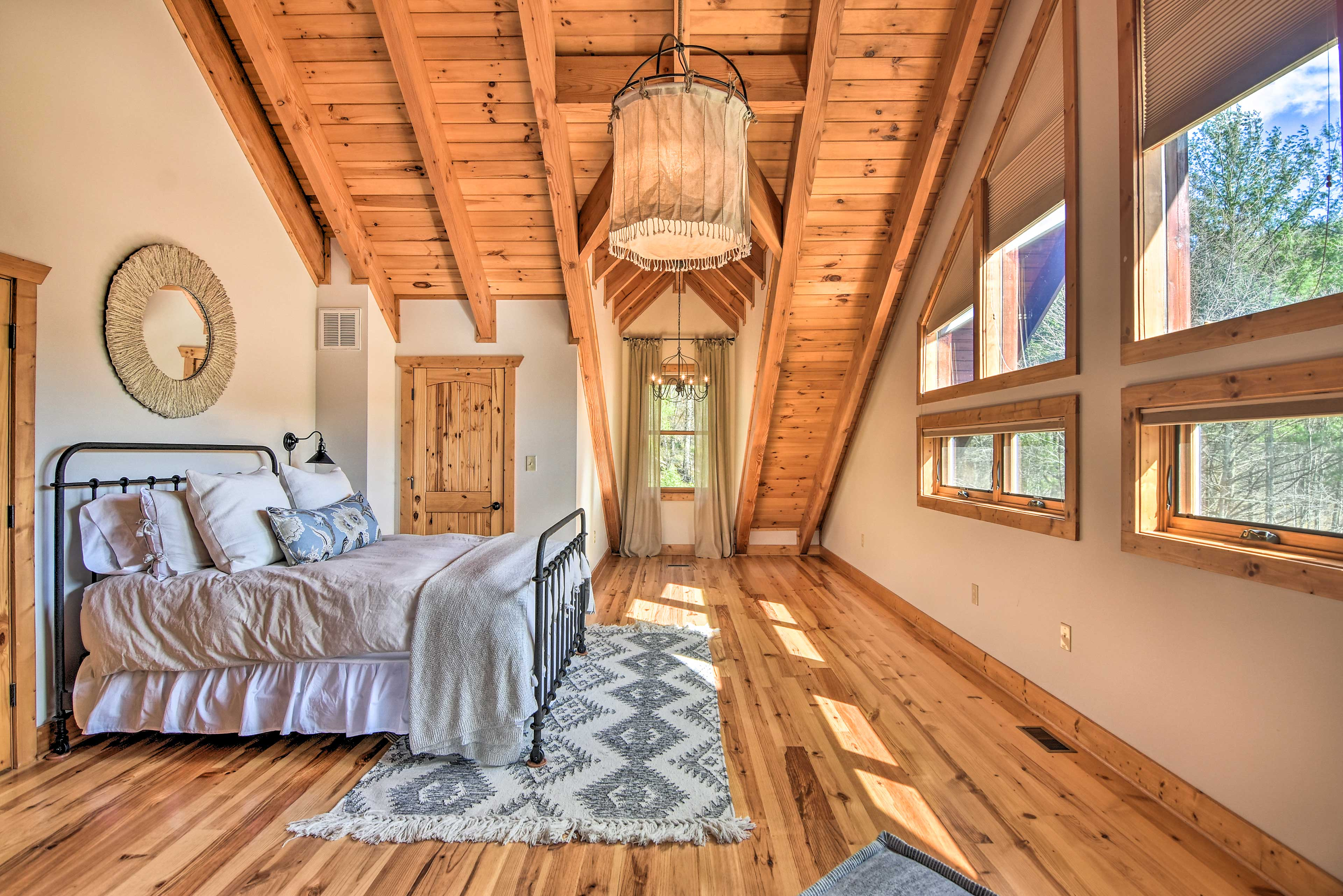 Wake up to sunlight streaming in on this lofted queen-sized bed.