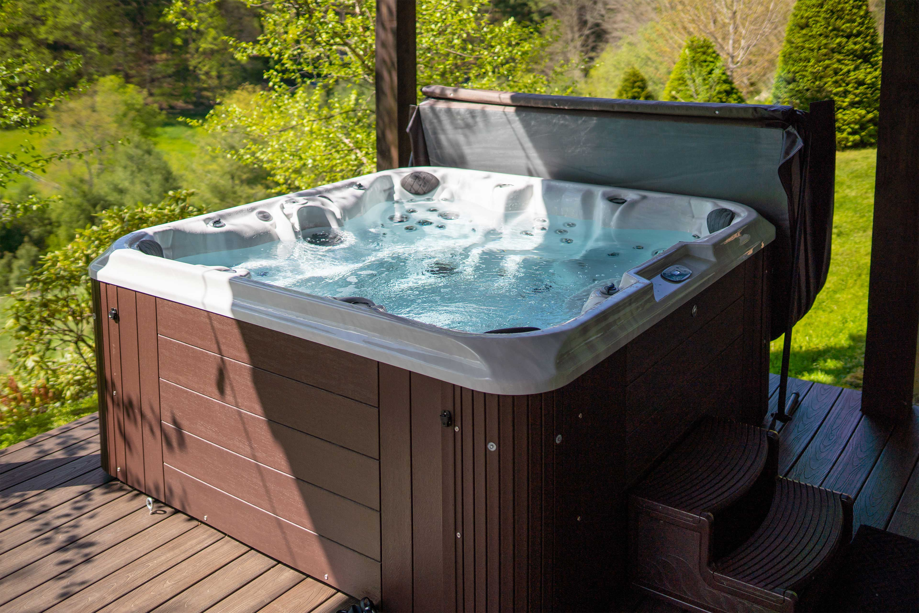 Watch was your worries melt away in the private hot tub.