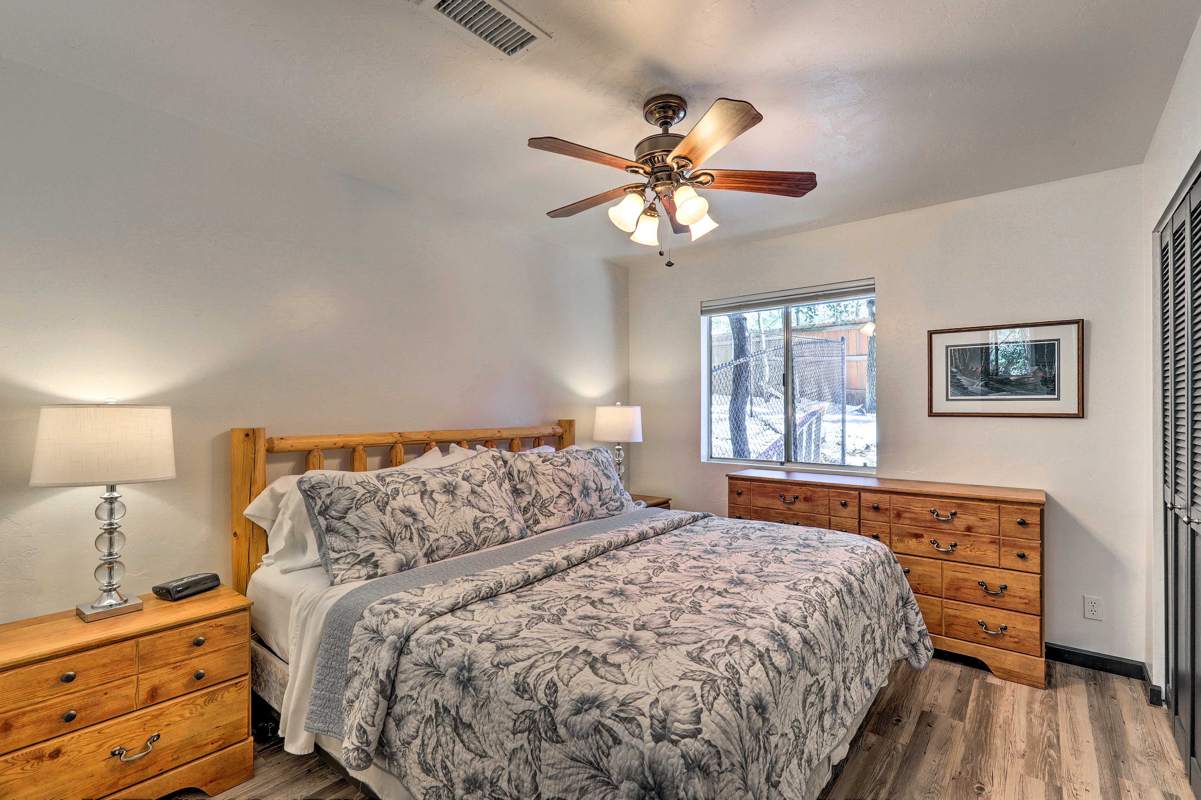 Take solace in the master bedroom with a king bed and dresser.