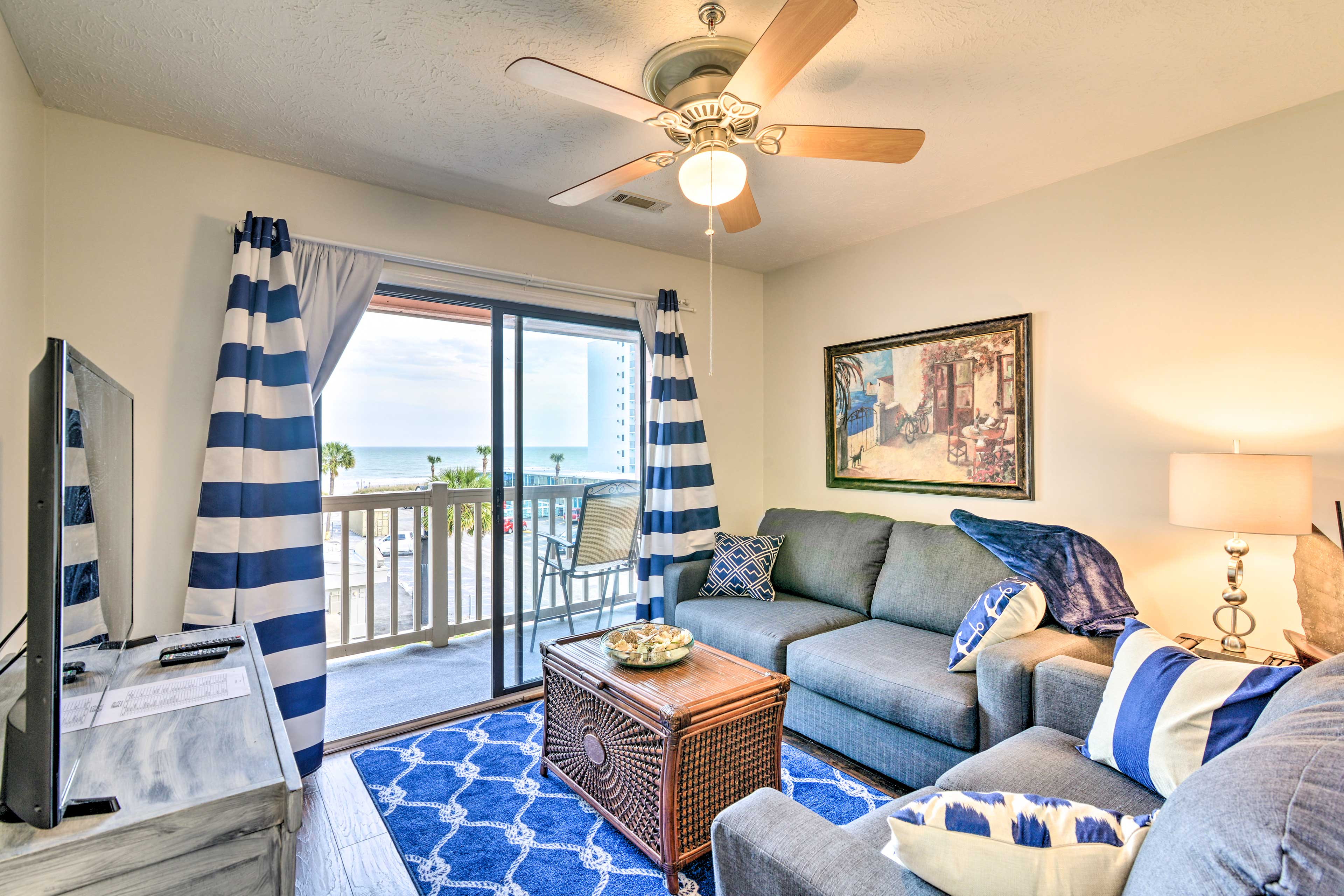 Enjoy a cool drink in this Myrtle Beach condo's living room!