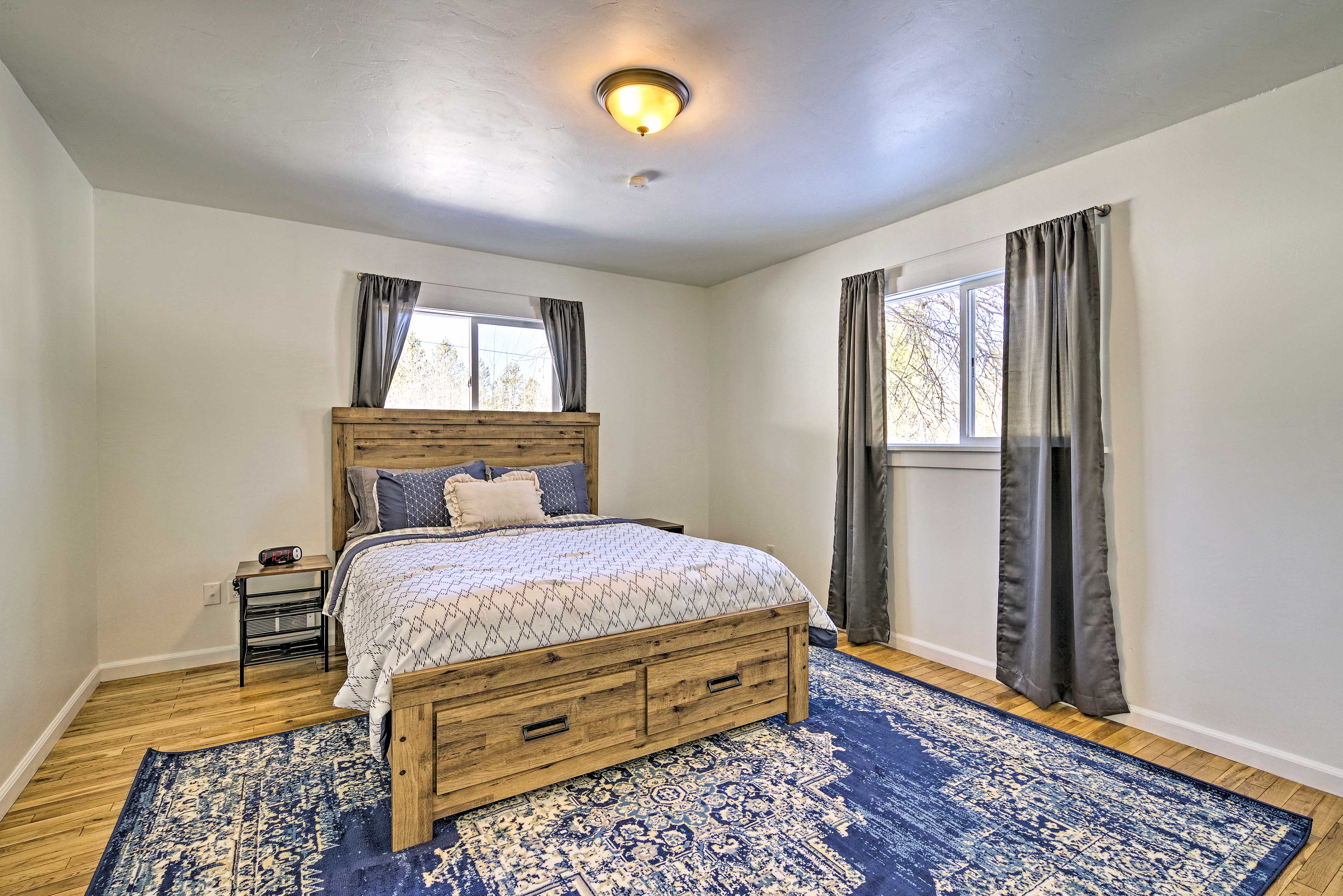 The second bedroom is equipped with a queen bed.