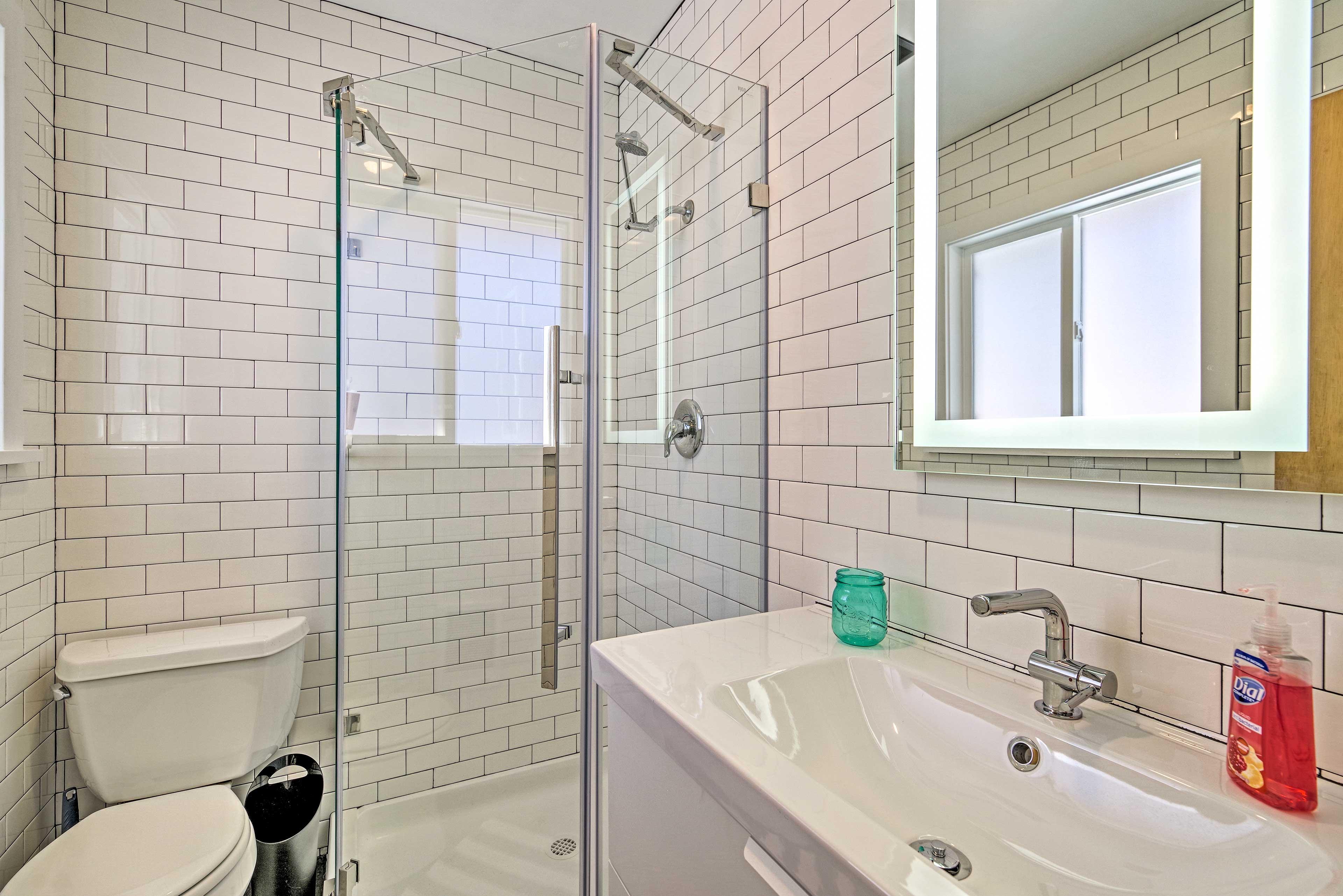 The en-suite features a walk-in shower.