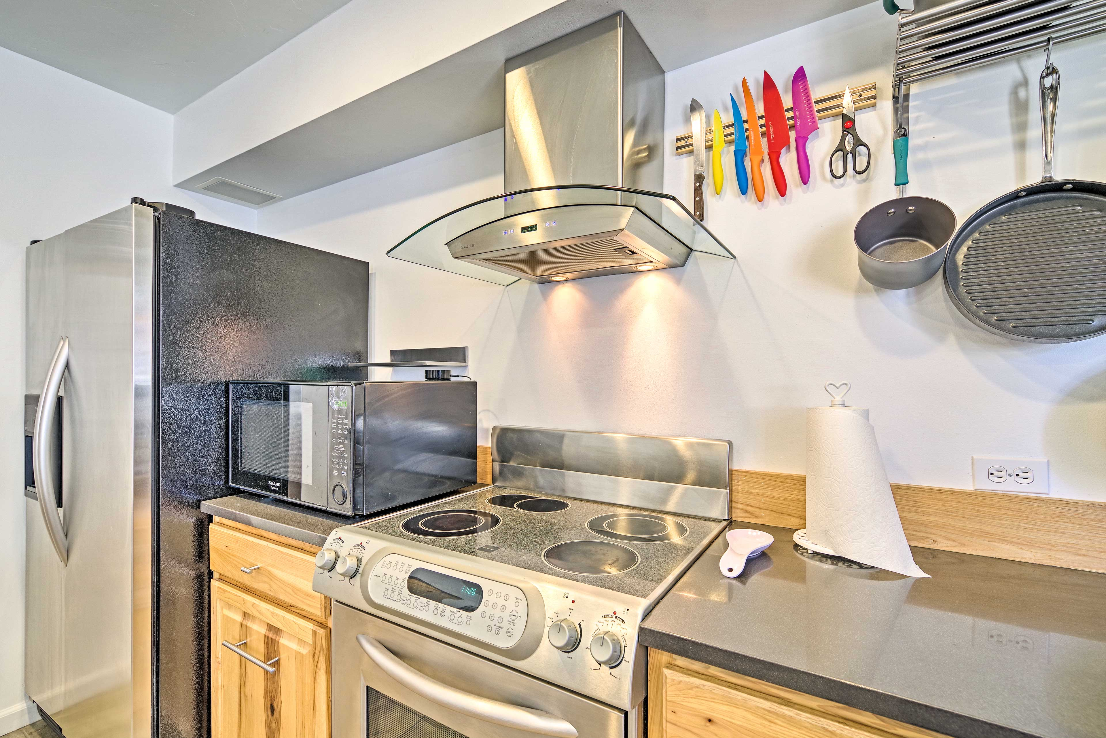 Stainless steel appliances complement the updated kitchen.
